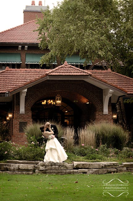 Bride and groom in front of Oak Park Country Club in River Grove Illinois