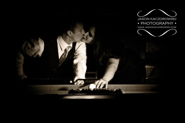 Black and White photo of engagement session at pool hall
