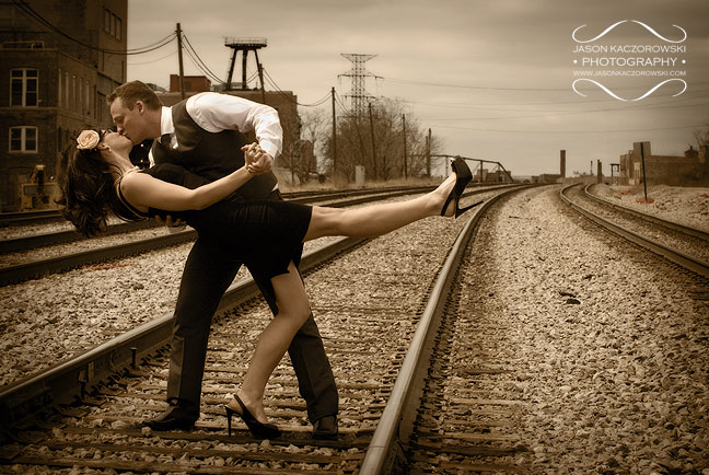Engagement Session photo kissing on train tracks