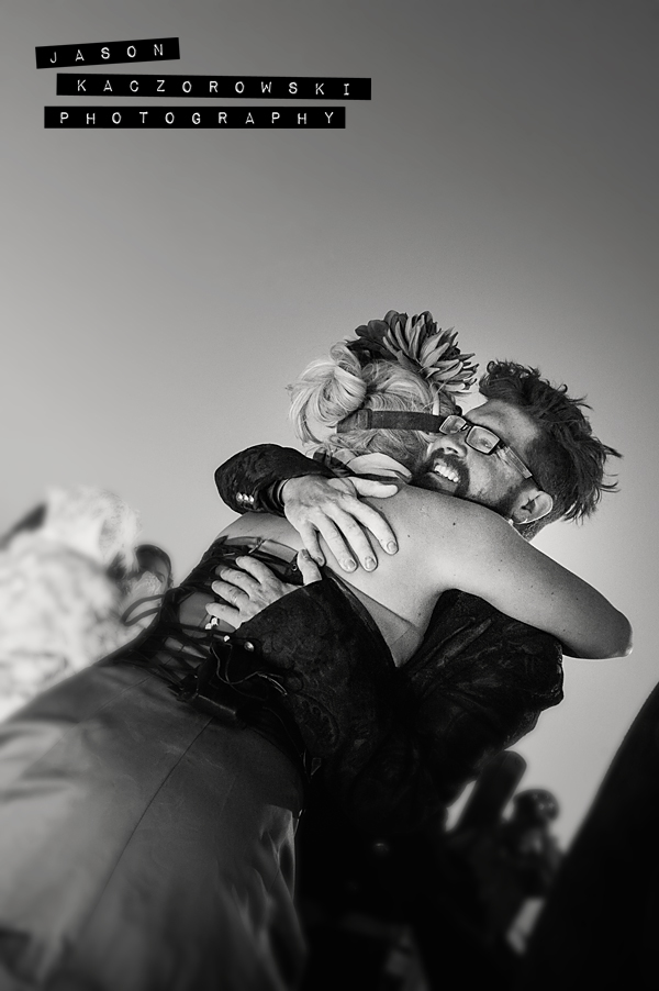 Groom Hugs Bridesmaid Burning Man 2015