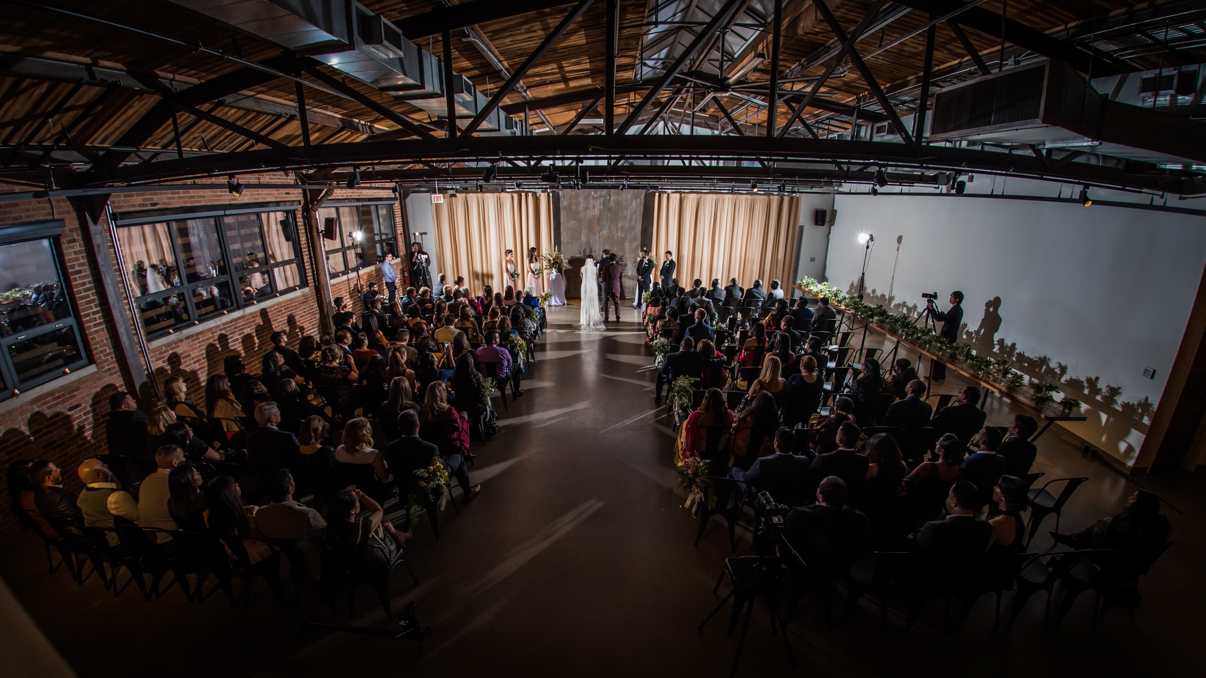 Artistic photo of wedding ceremony at the industrial wedding venue Ovation on the west side of Chicago-280