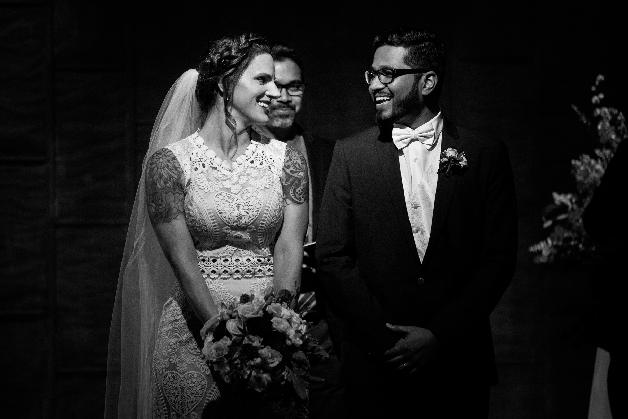 Black and White of happy couple after their wedding ceremony at Ovation Chicago