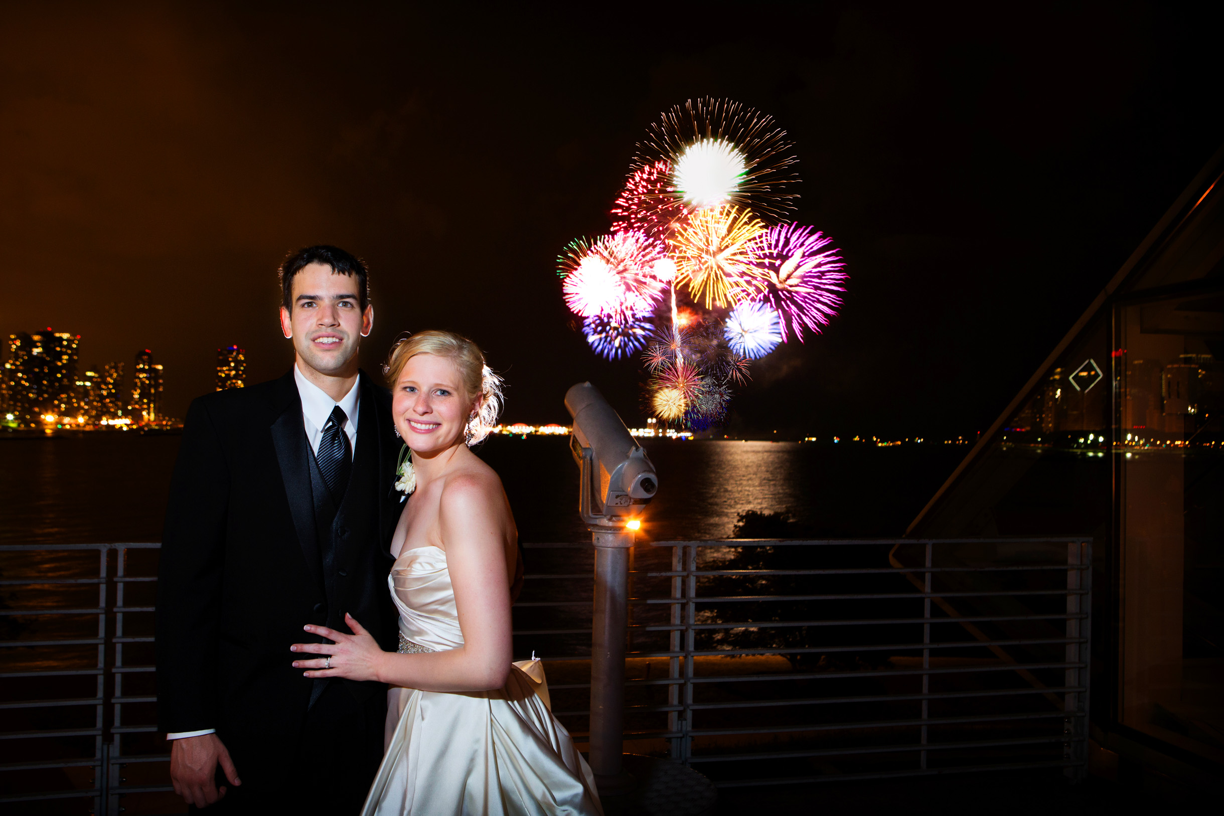 Bride and Groom at the Adler Planetarium with Fireworks from Navy Pier in the background-083