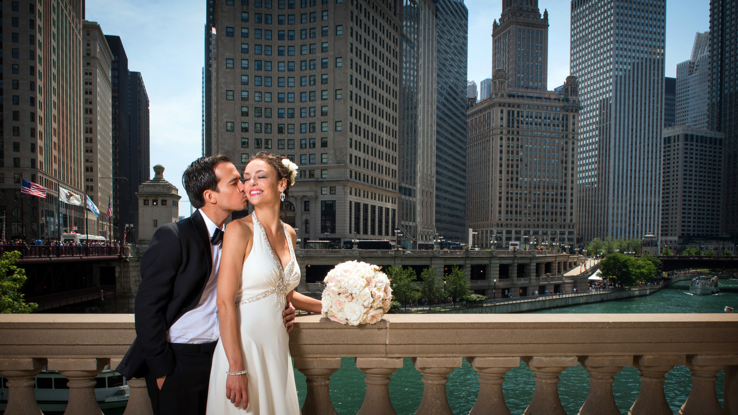 Bride and Groom at the Wrigley Building in Chicago on their wedding day with skyline-1