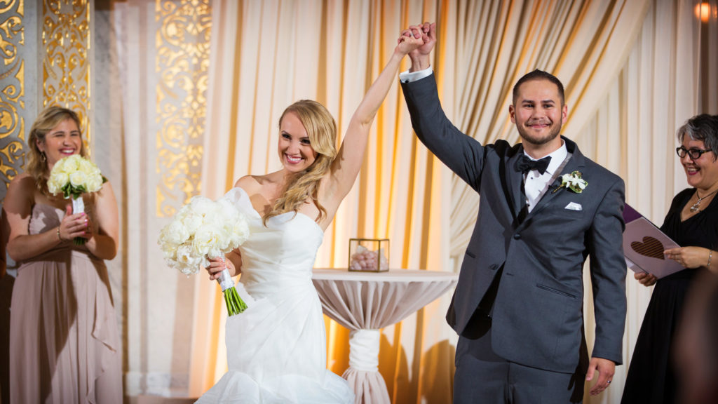 Bride and Groom celebrating after their wedding ceremony at the Rookery in Chicago-289