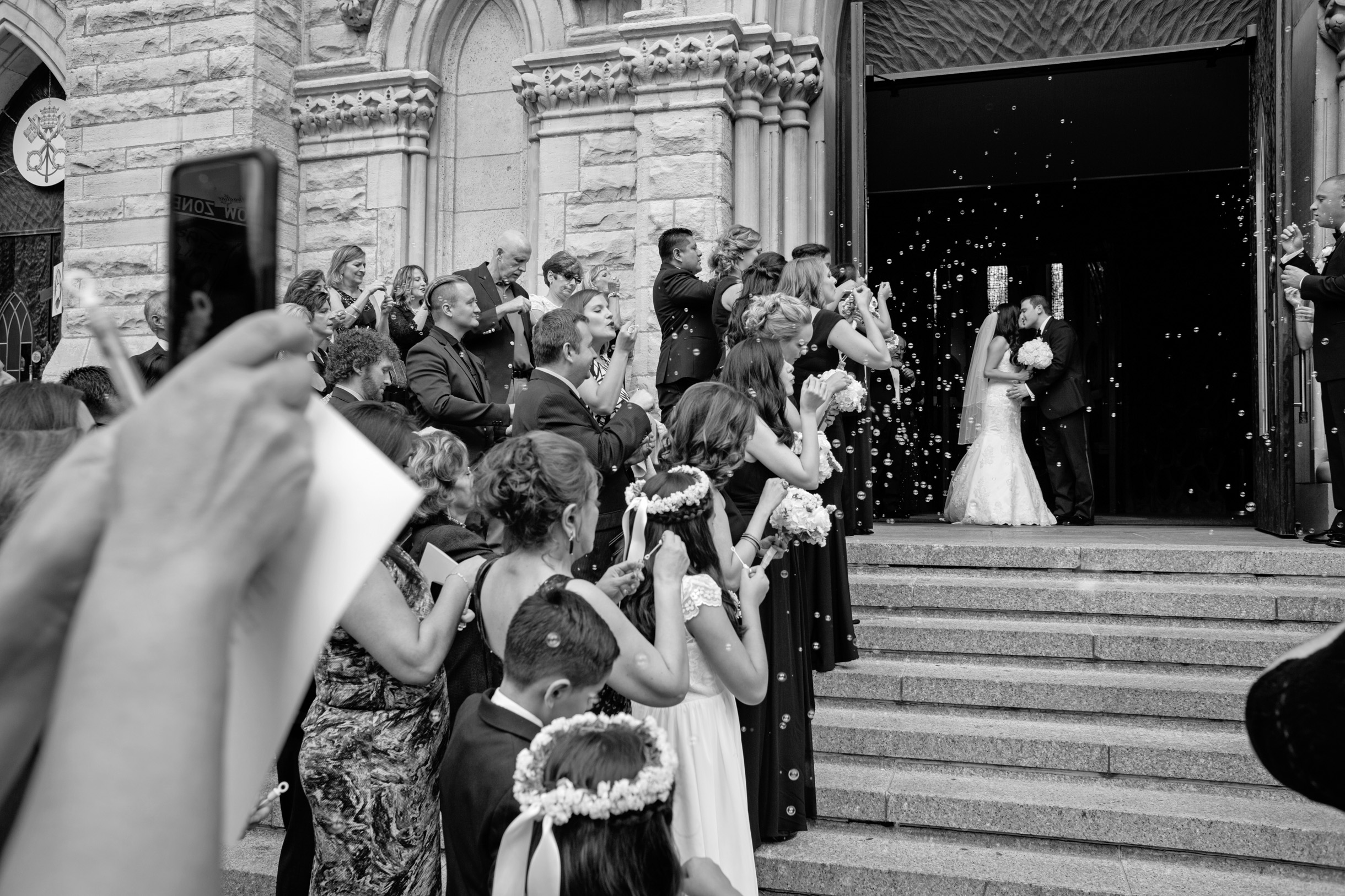 Bride and Groom coming out of church during their wedding ceremony on the steps of Holy Name Cathedral in Chicago-206