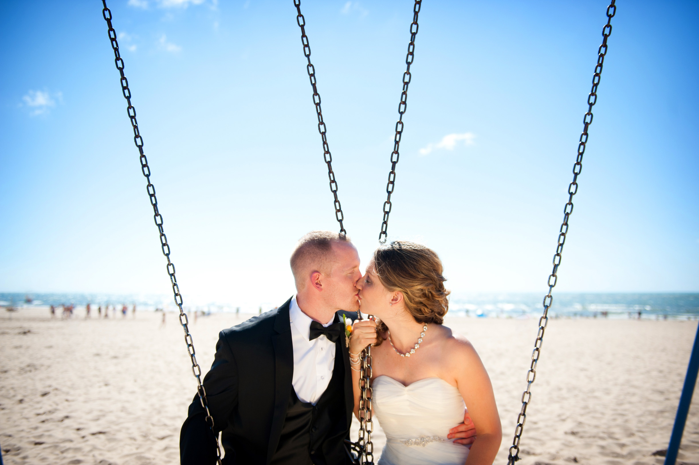 Bride and Groom on swing kissing at Beach Destination Wedding