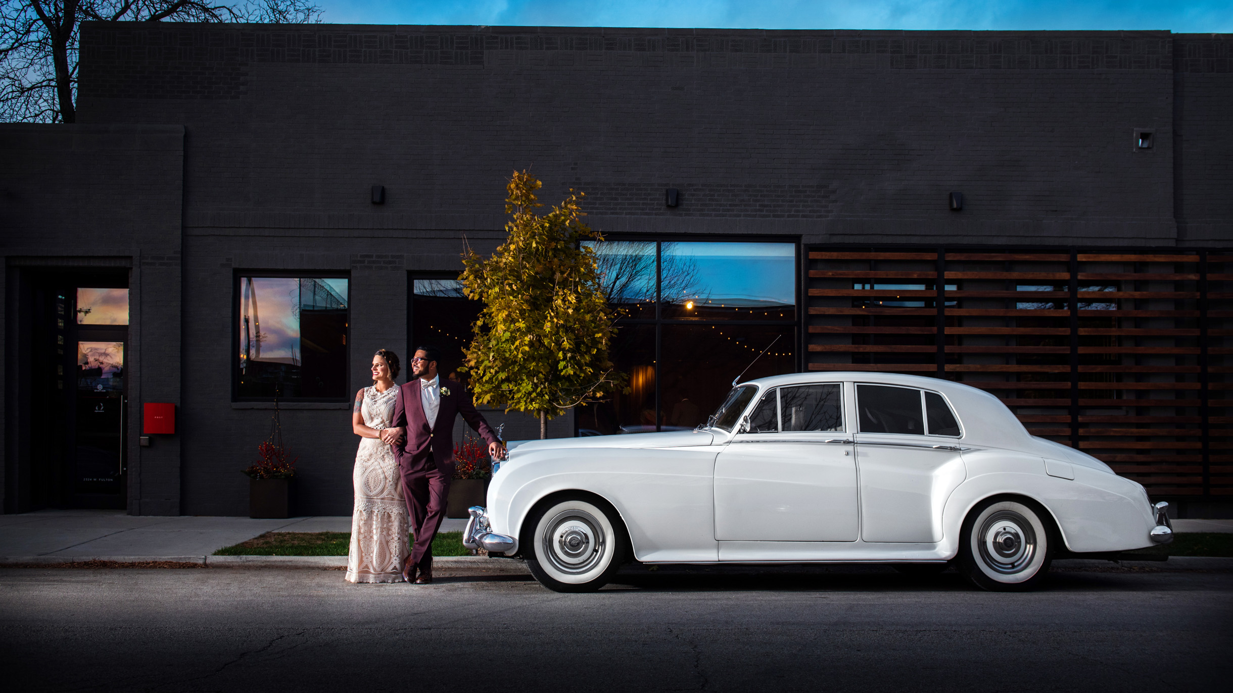 Bride and Groom posing with a classic car after their wedding at Ovation Chicago-010