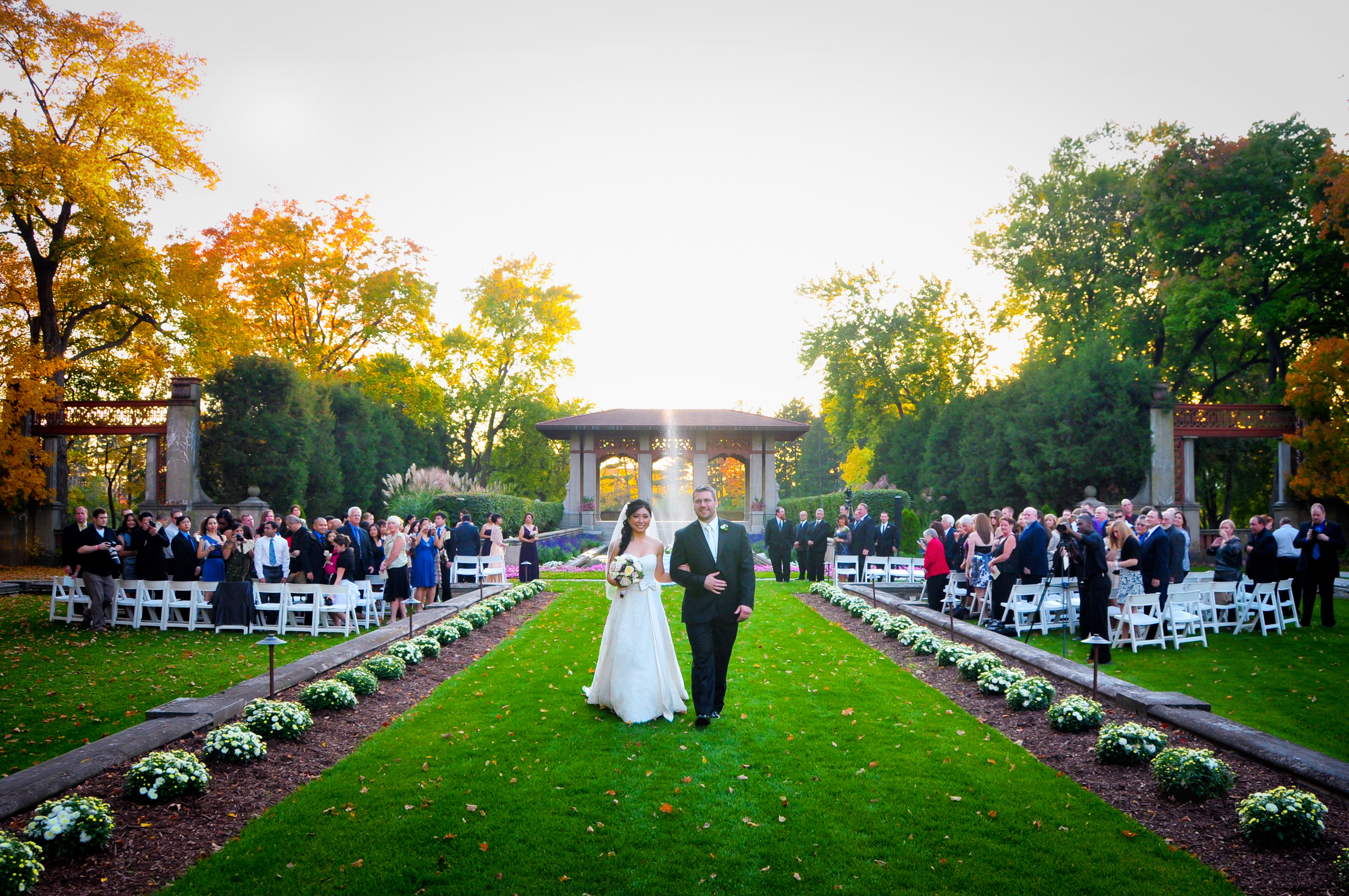 Bride and groom coming down the aisleafter their ceremony at armour house garden wedding at Lake Forest Academy-146