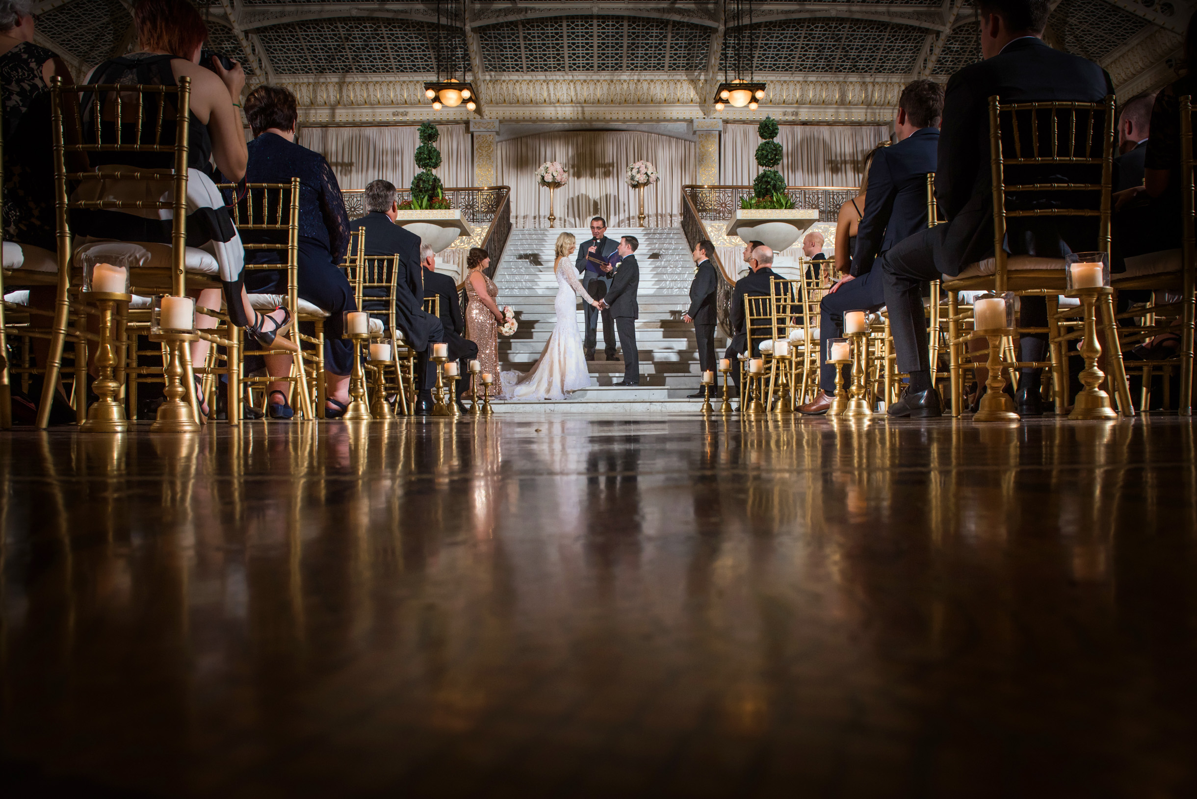 Bride and groom exchange vows on staircase at Rookery in Chicago