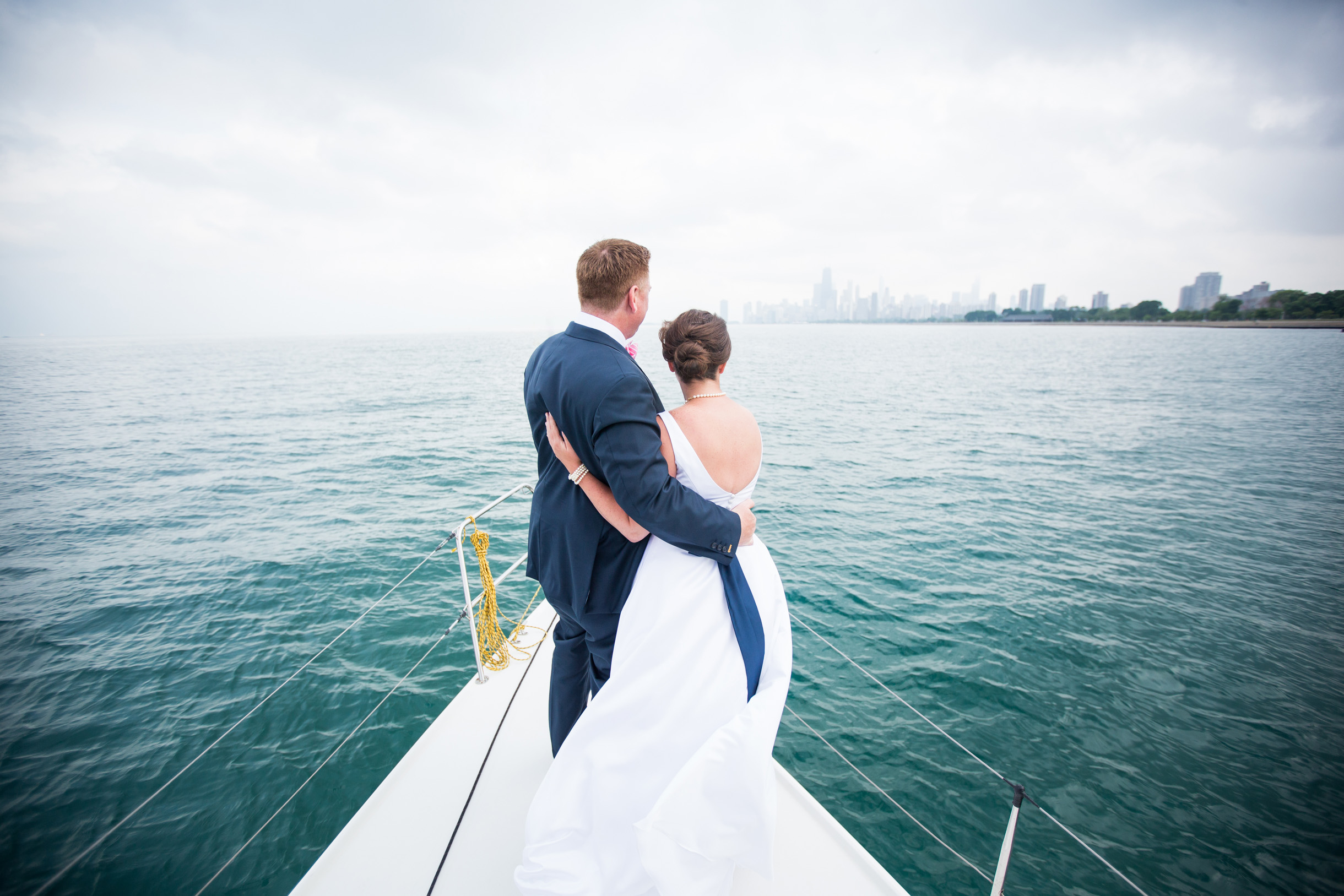 Bride and groom sailing to their wedding reception at the Chicago Yacht Club