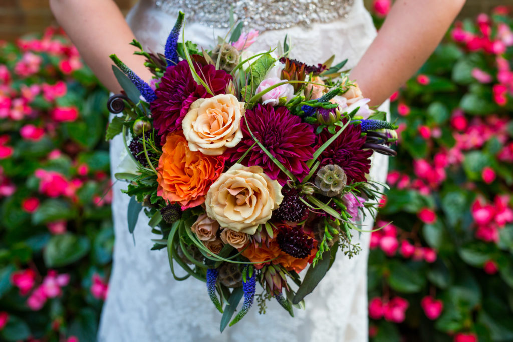 Bride colorful bouquet with wildflowers and roses