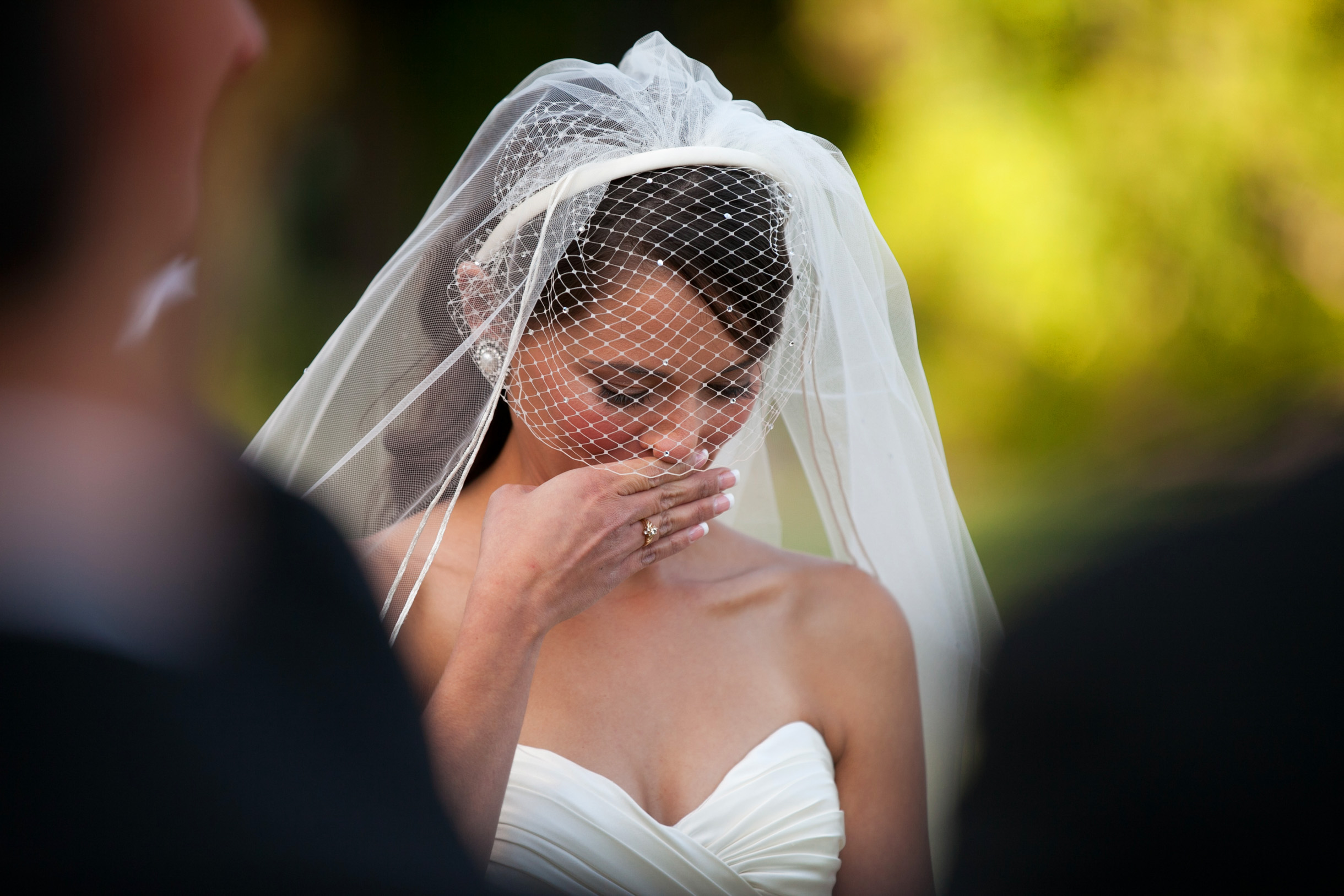 Bride crying tears of joy during her outdoor wedding ceremony