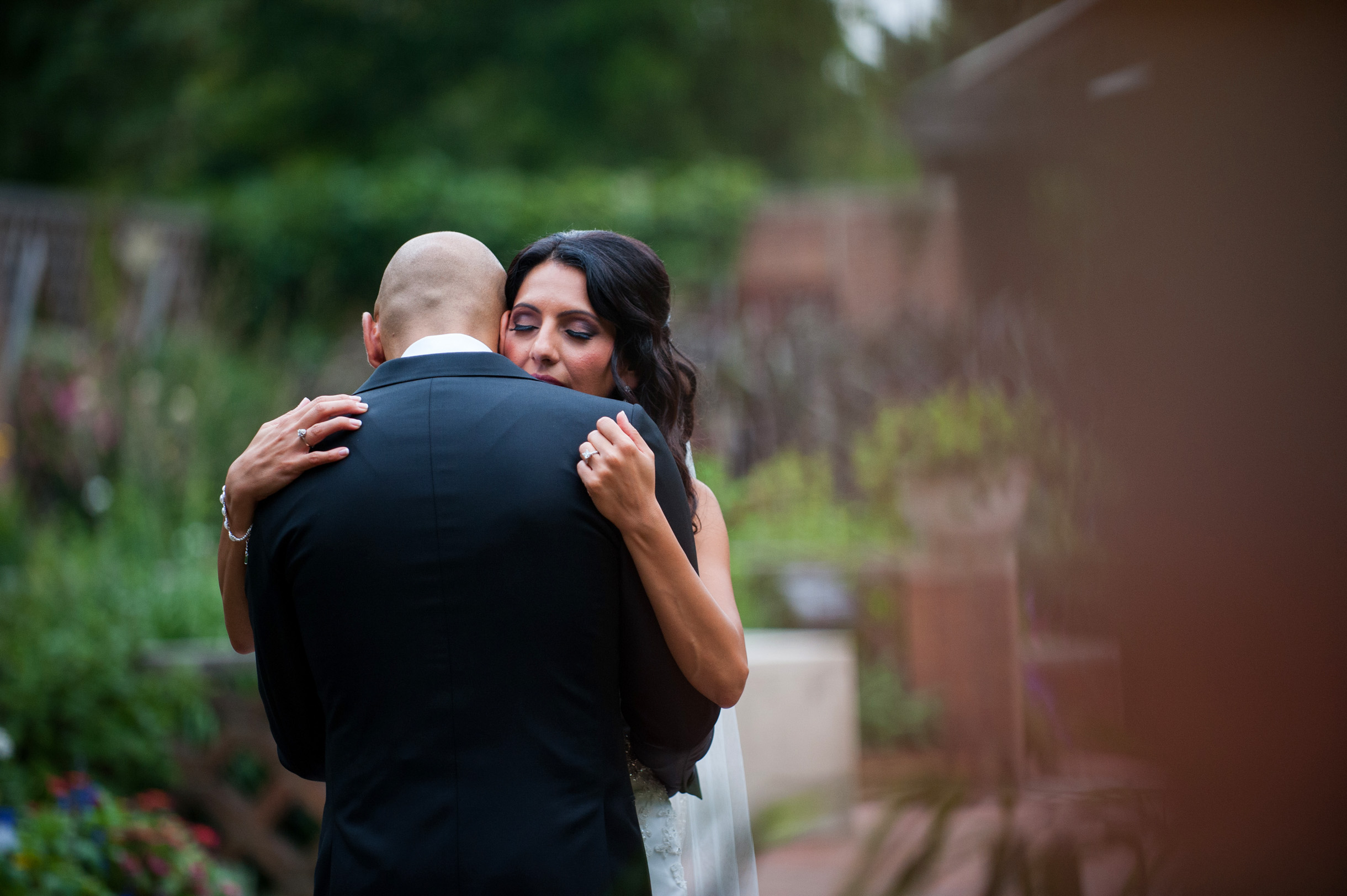 Bride embracing groom during first look at Chicago Botanic Garden