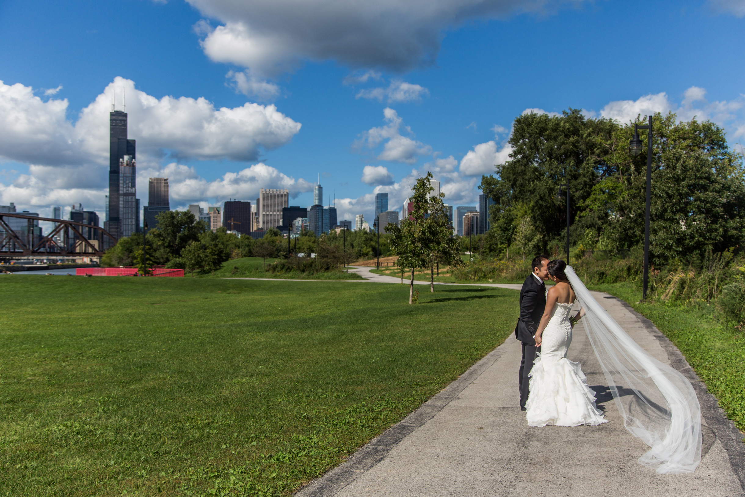 Bride's veil blowing in the wind with Chicago skyline in background