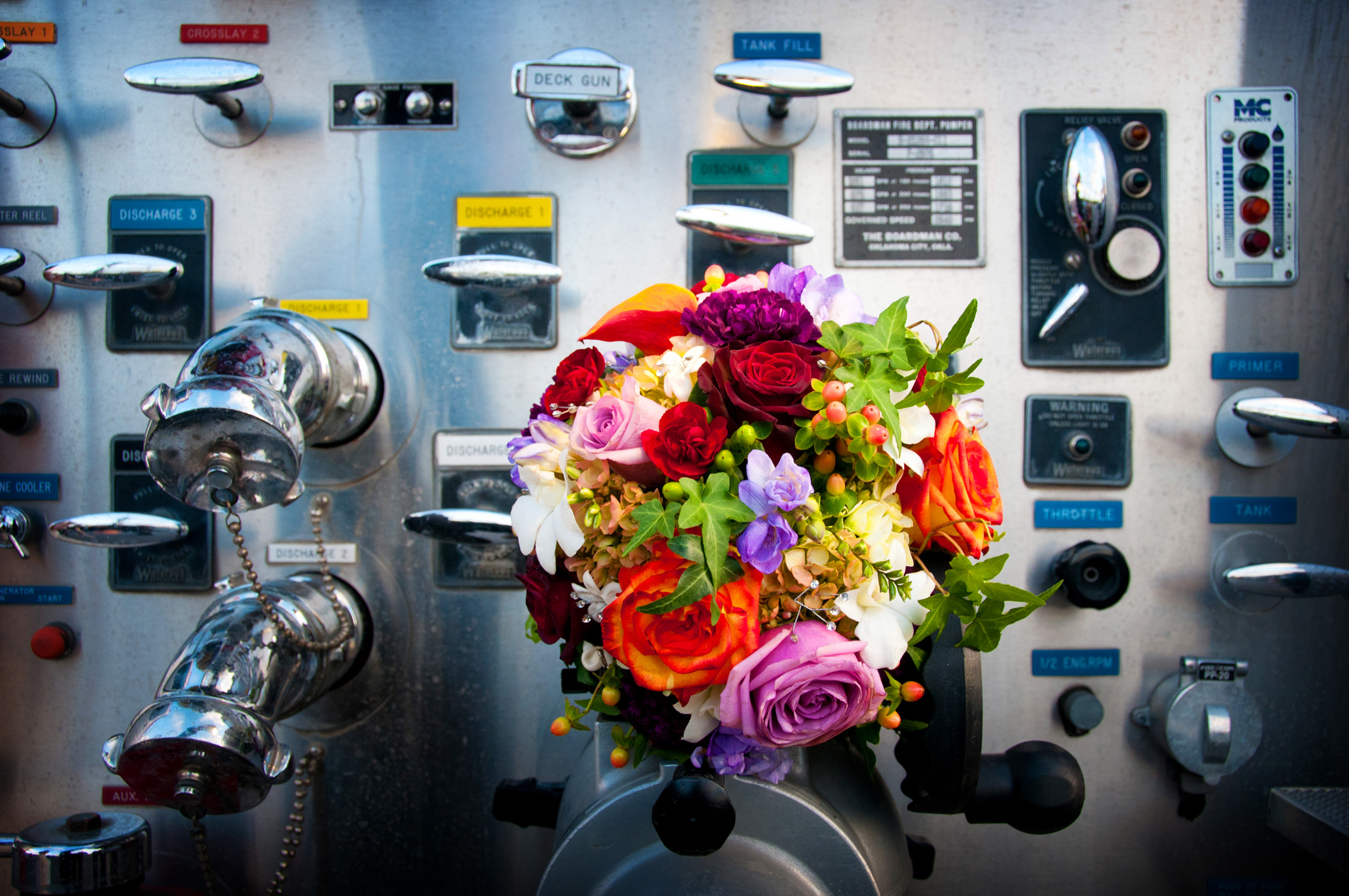 Bride's wedding bouquet on fire truck