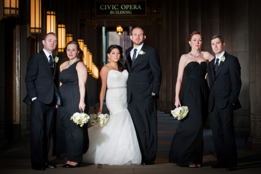 Dramatic wedding party photo at the Lyric Opera in Chicago
