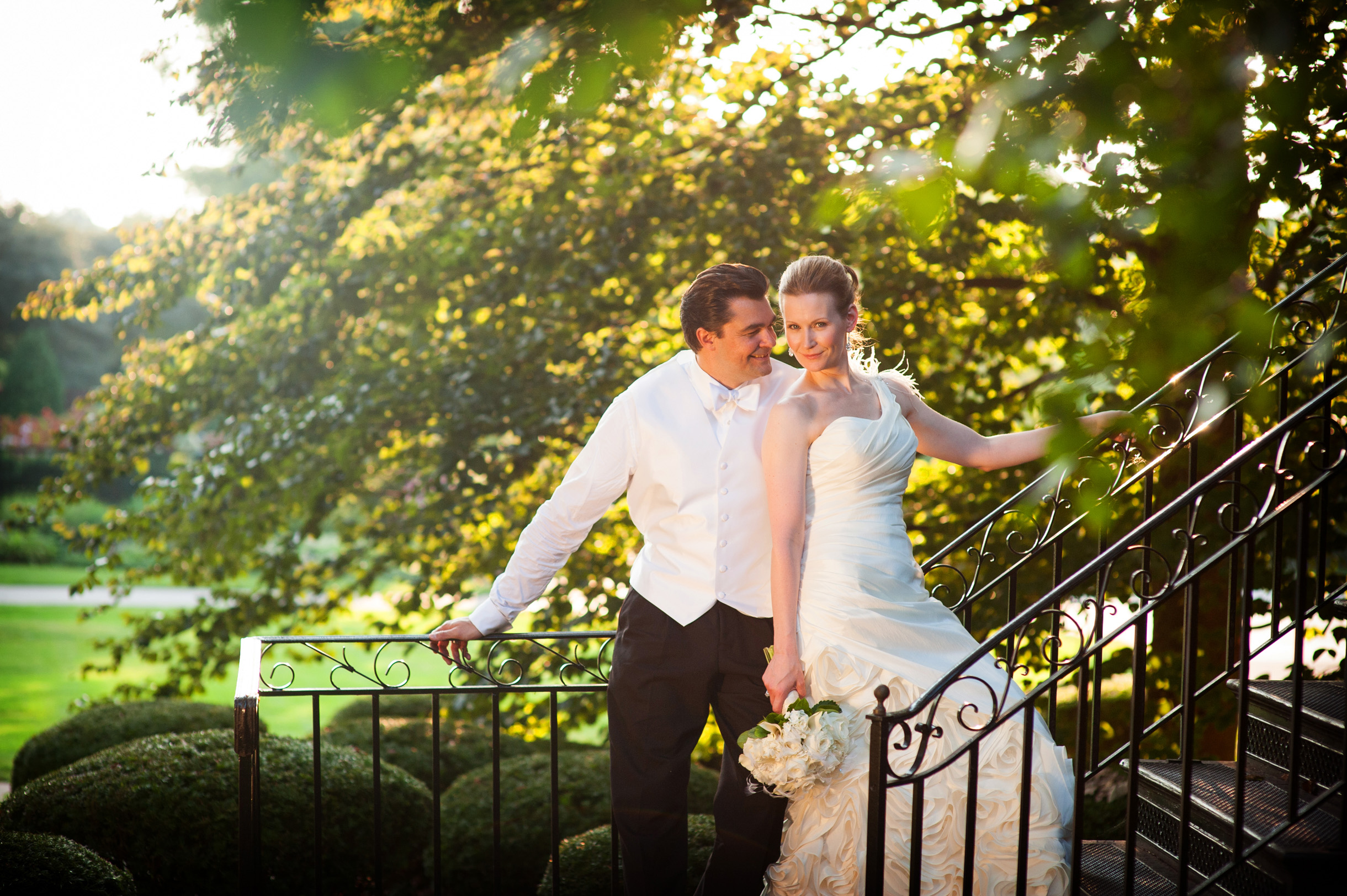 Fall wedding at Cantigny Park in Wheaton featuring a bride and groom under trees-358