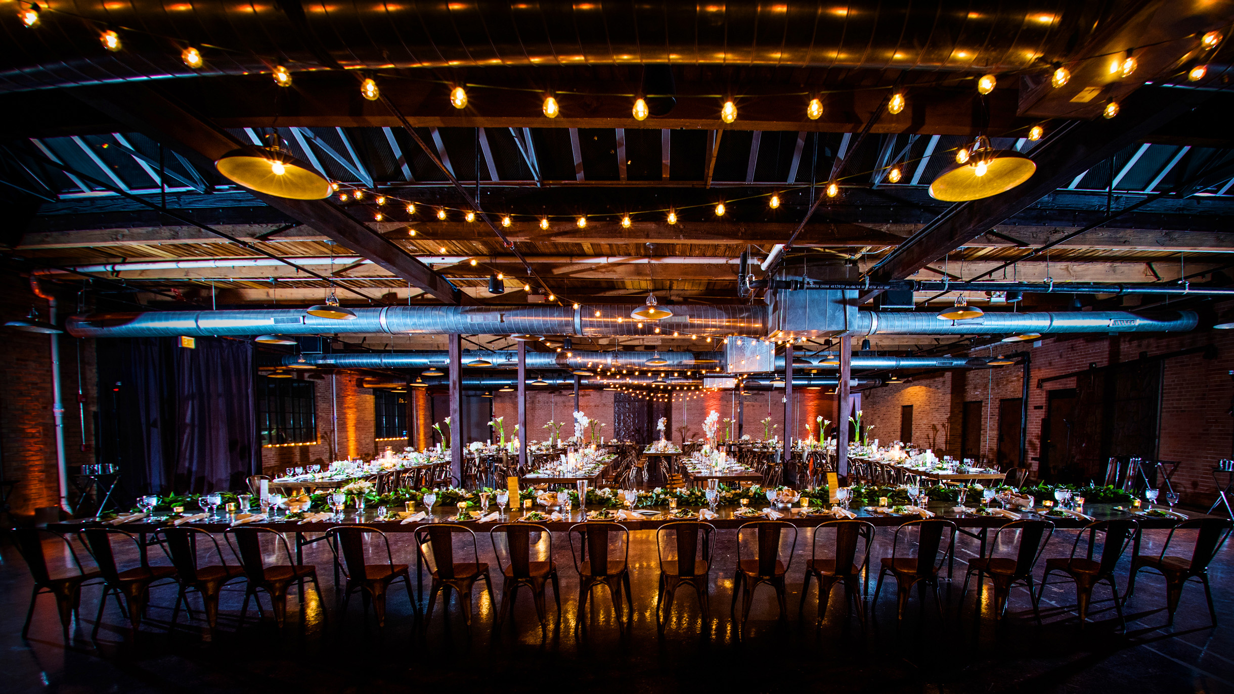 Farm style tables decorated for a wedding reception at Morgan Manufacturing in Chicago-032