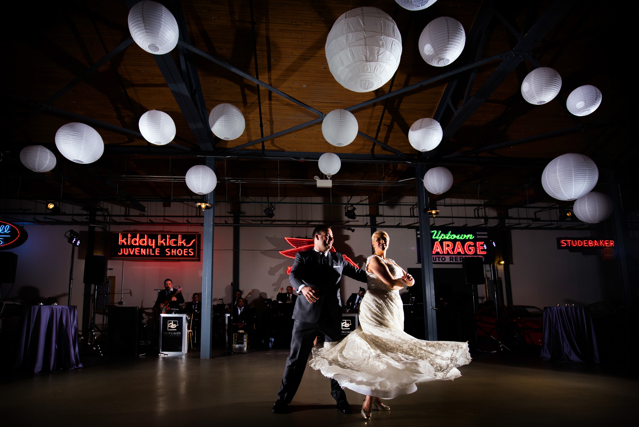 First Dance with Bride and Groom beneath paper lanterns at Chicago Ravenswood Event Center-119