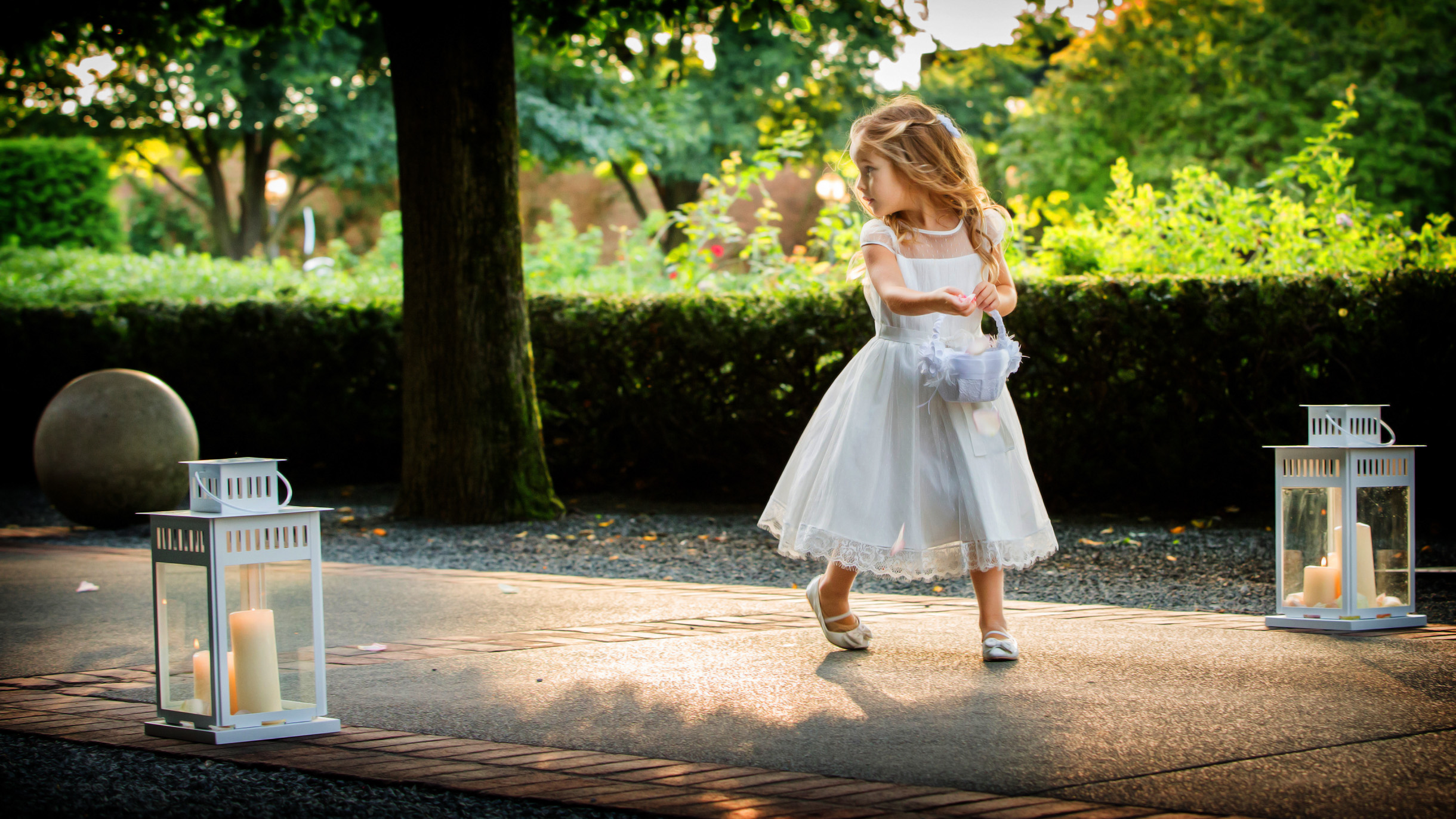 Flowergirl running down the aisle of a wedding ceremony in the Rose Terrace of the Chicago Botanic Garden-163