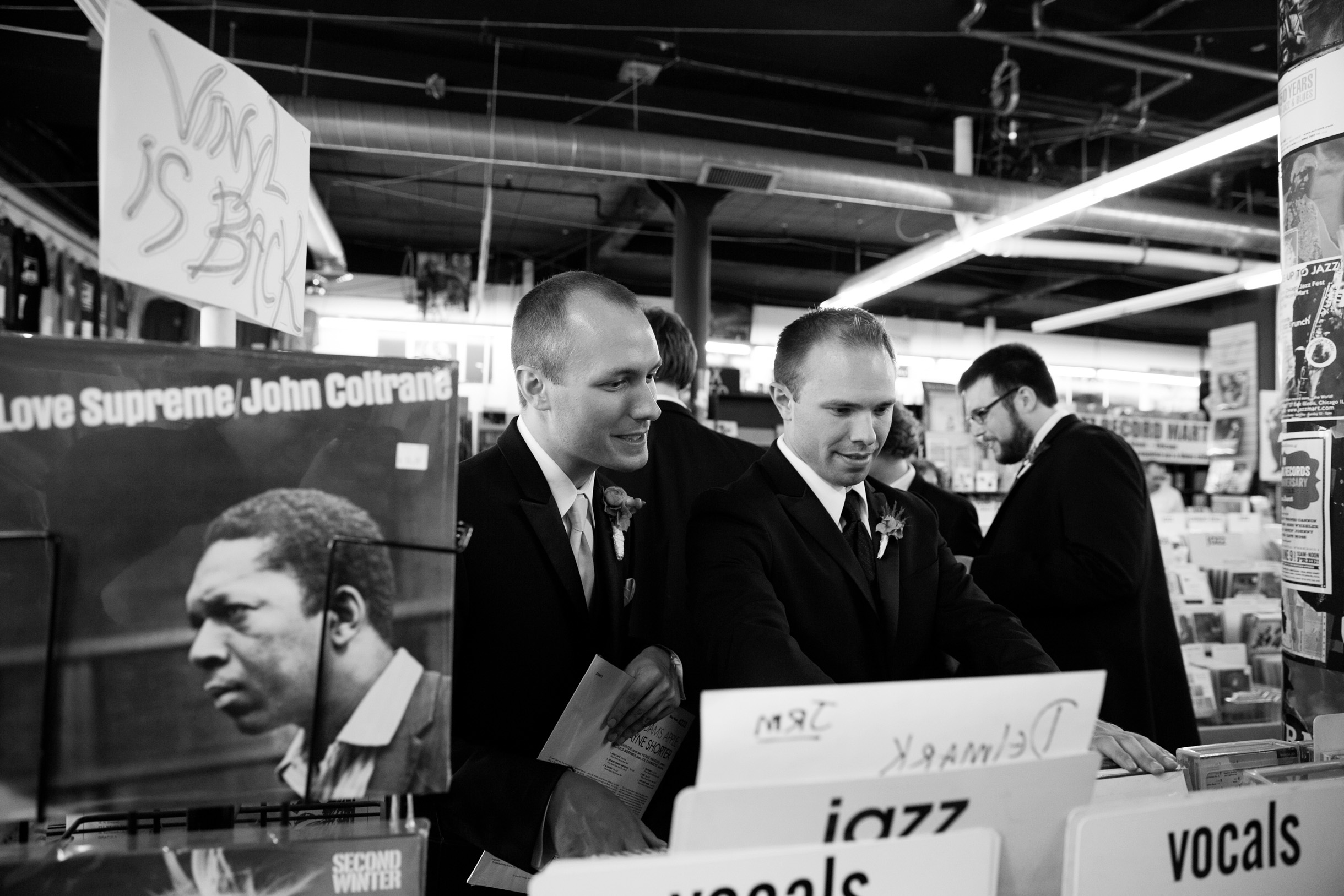 Groom buying vinyl records on his wedding day