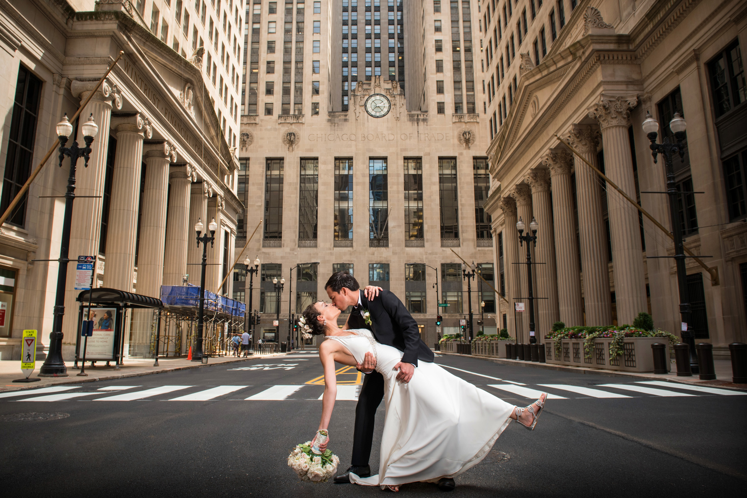 Groom dipping bride on LaSalle Street in front of the Board of Trade
