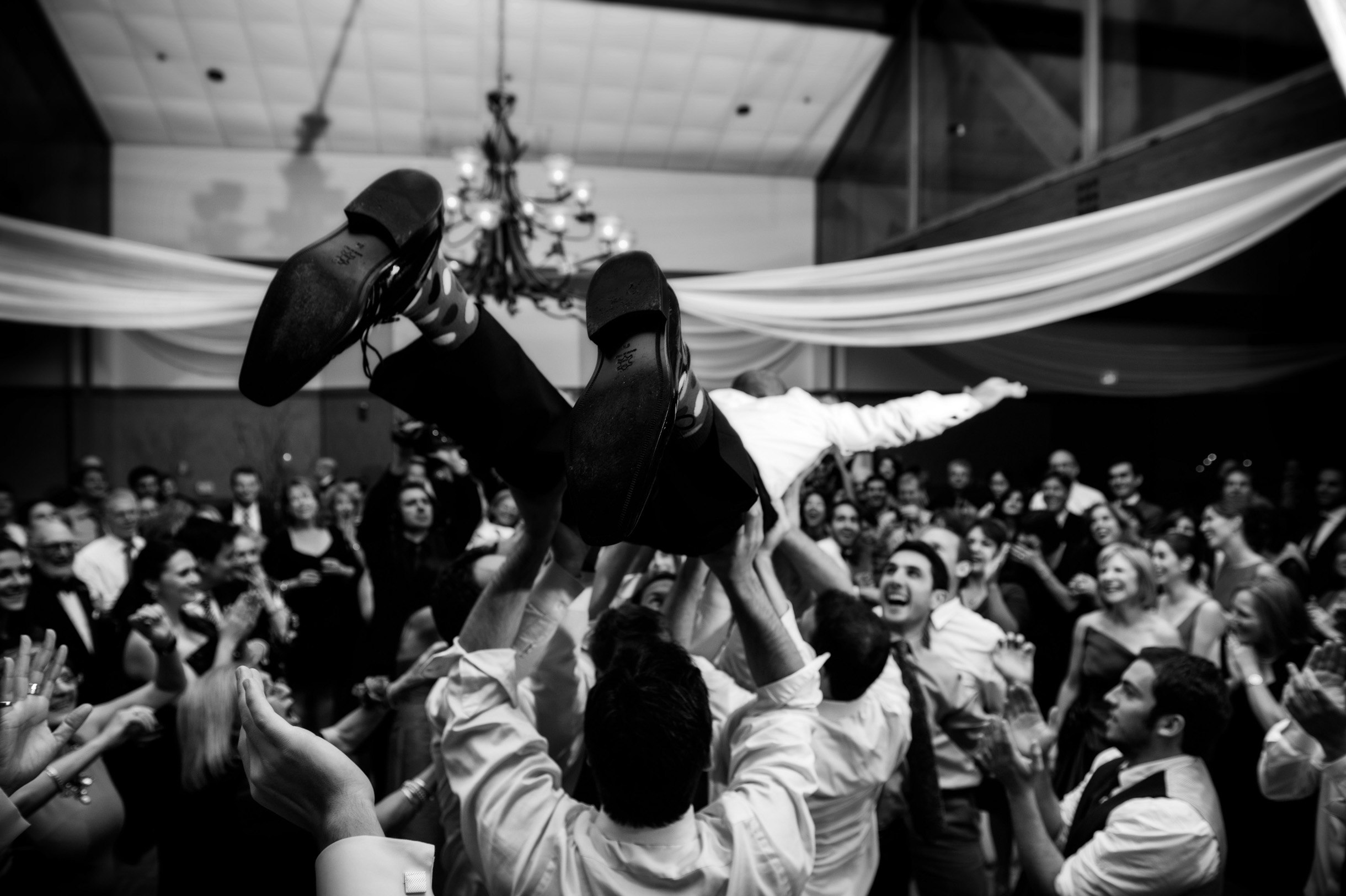 Groom jumping off stage to crowd surf on his wedding guests hands