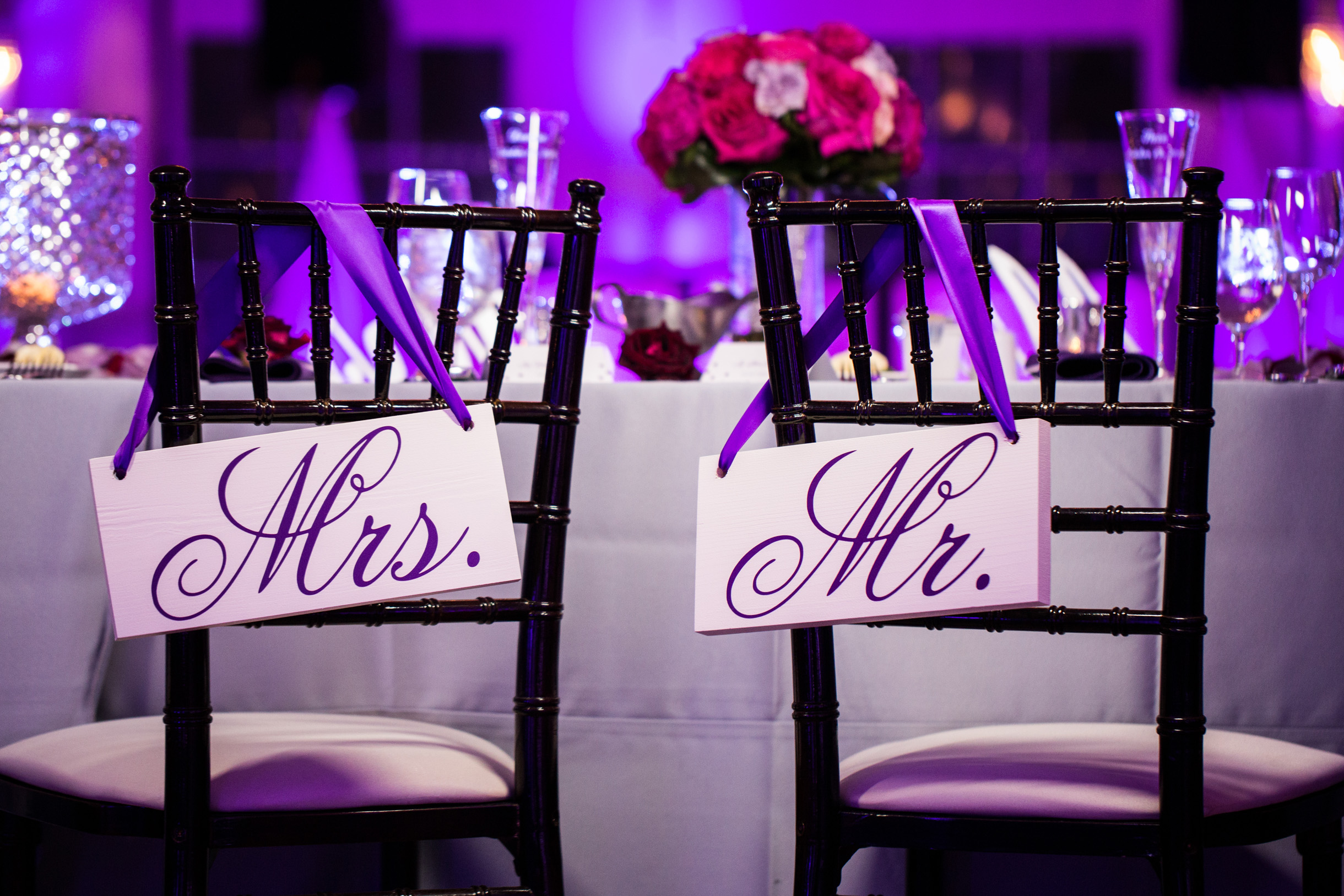 Purple wedding reception decor with Mrs and Mr signs