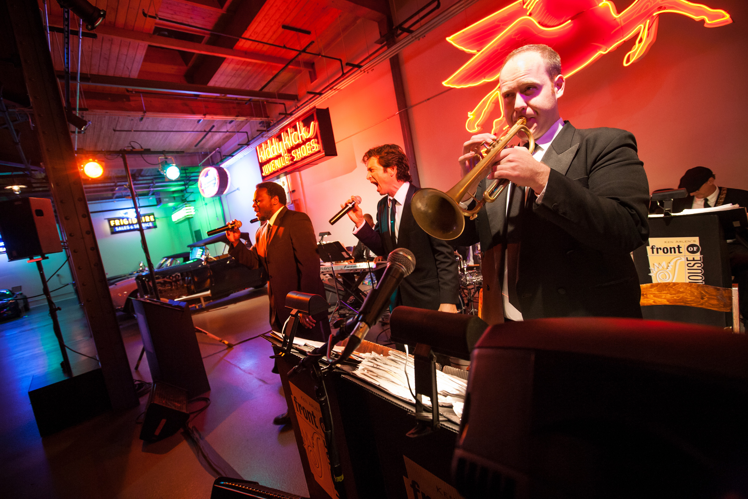Wedding band performing at Ravenswood Event Center in Chicago with neon signs and classic cars-133