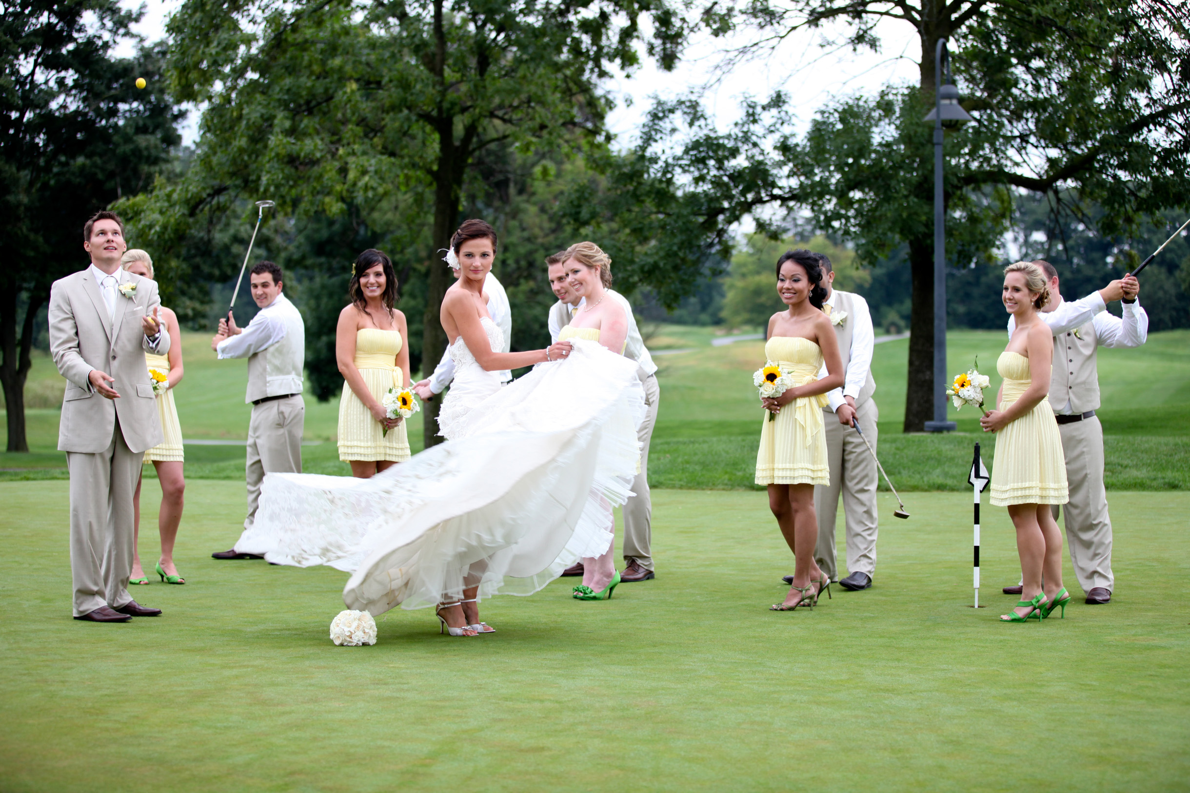 Wedding party ongolf course goofing around and acting funny