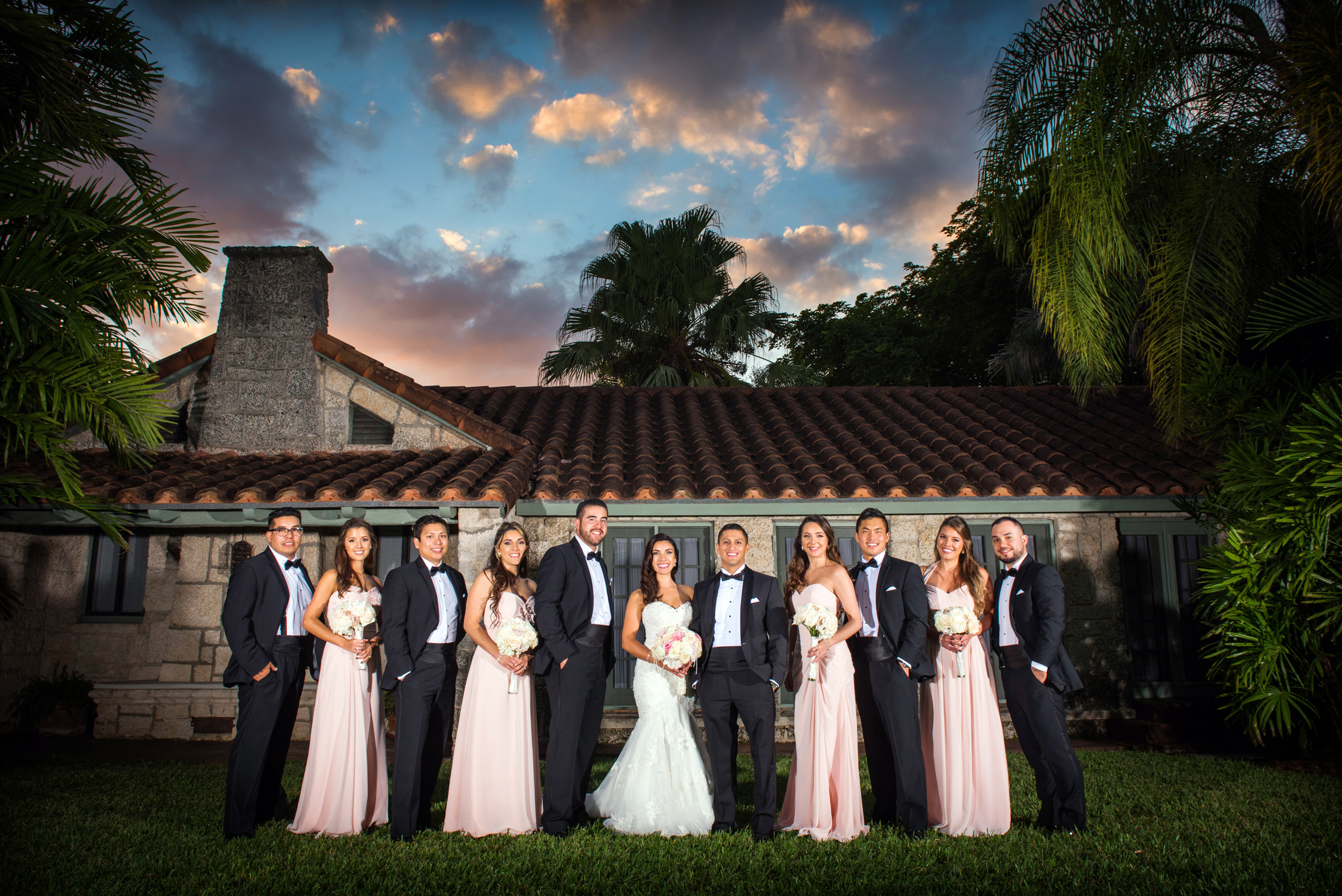 Wedding party posed by Spanish tile roof reception venue at the Cooper Estate in South Florida-017
