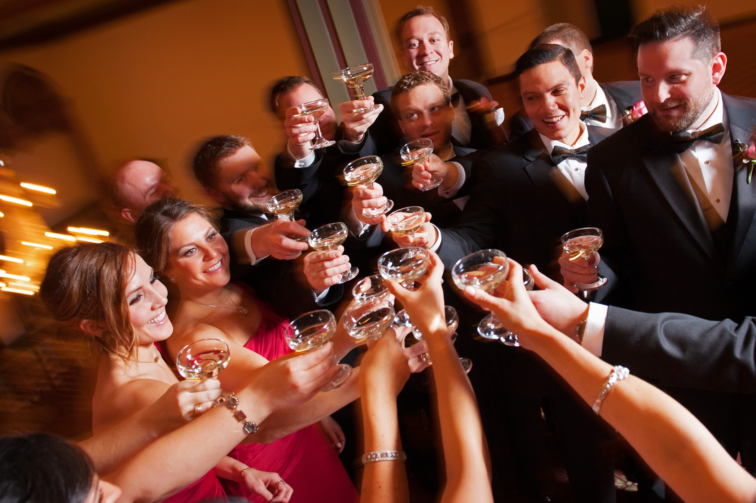 Wedding party toasting champagne glasses at Germania Place in Chicago