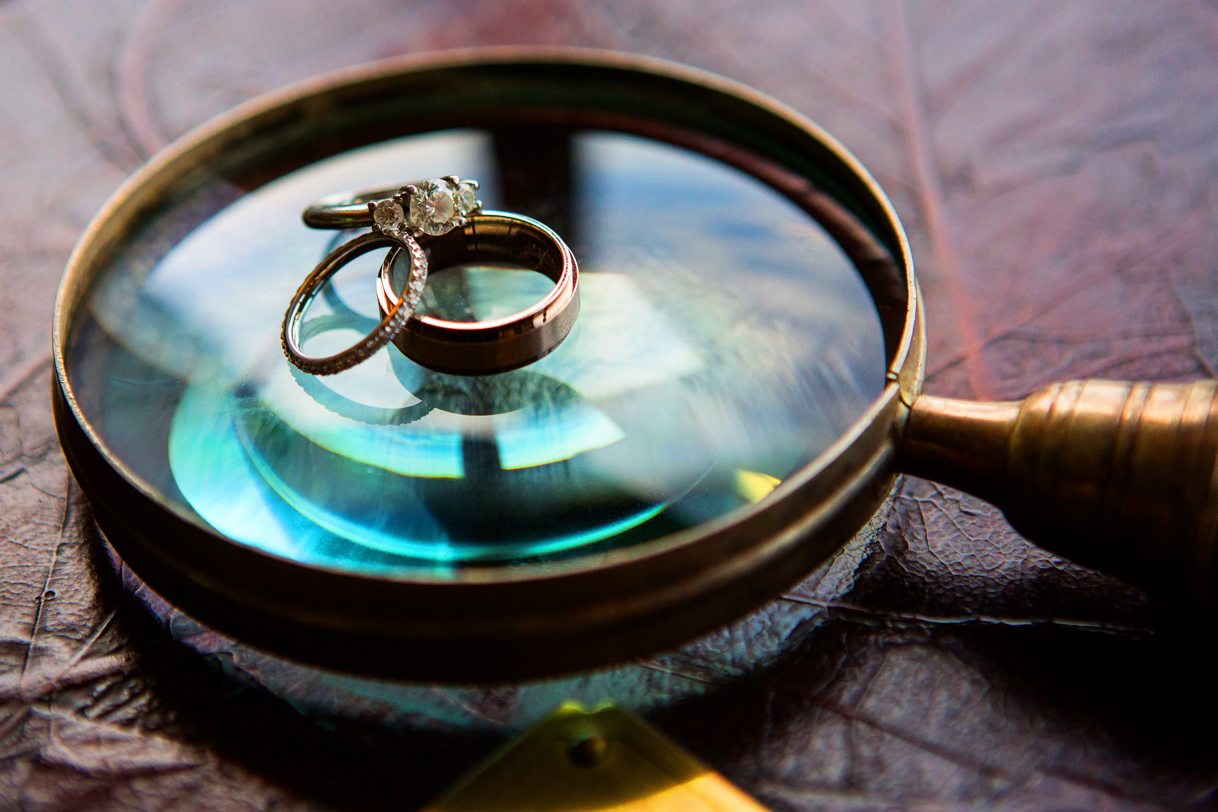 Wedding rings on a magnifying glass