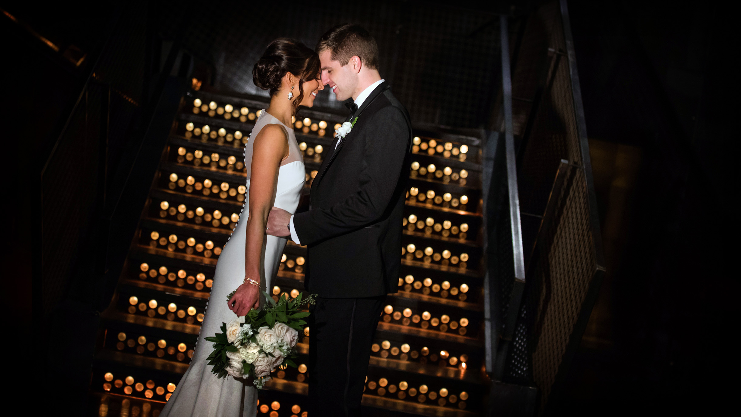 bride and groom on staircase at Morgan Manufacturing in Chicago