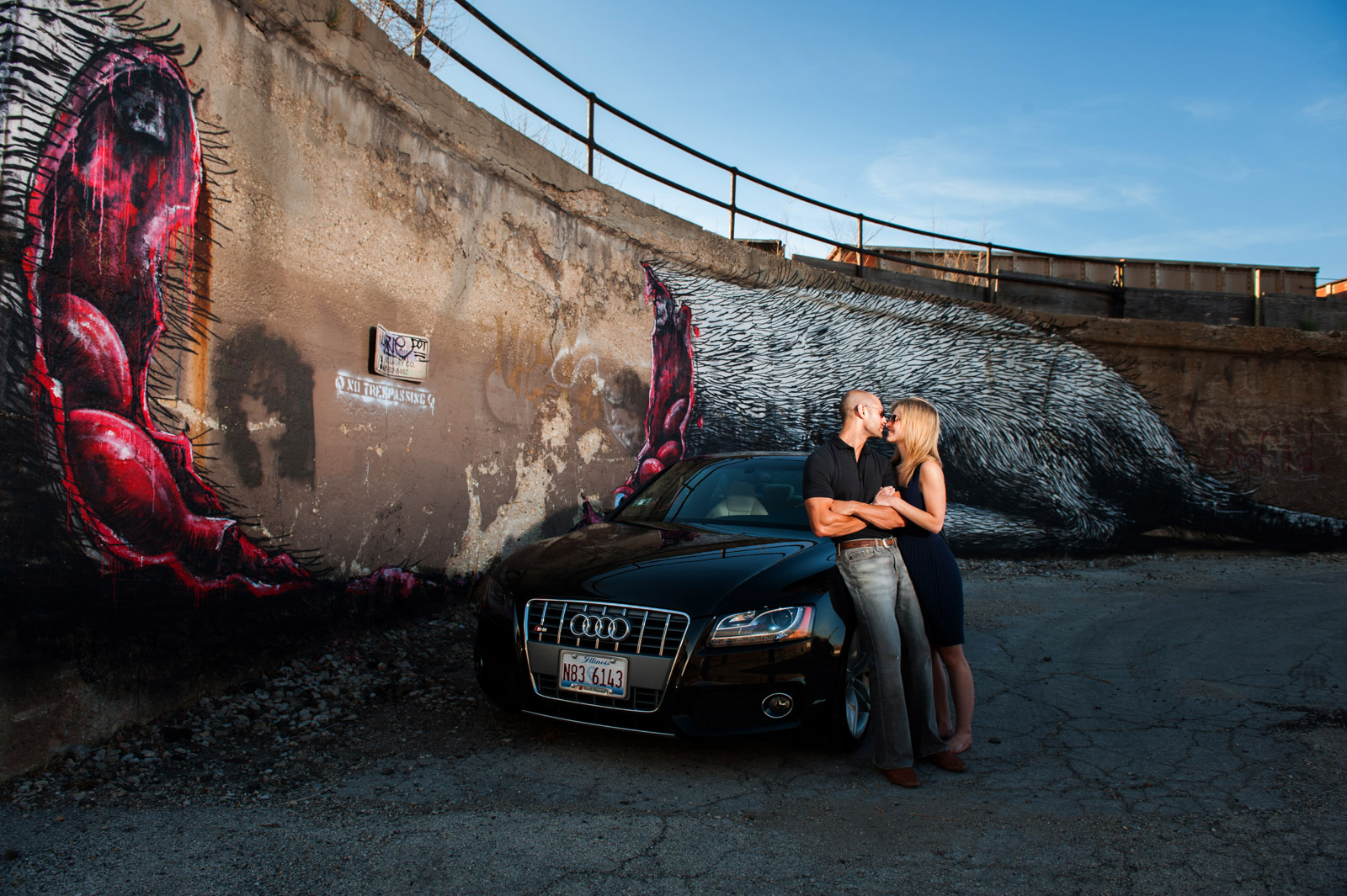 Engagement Session couple photographed in front of their car and urban street art in Pilsen by ROA