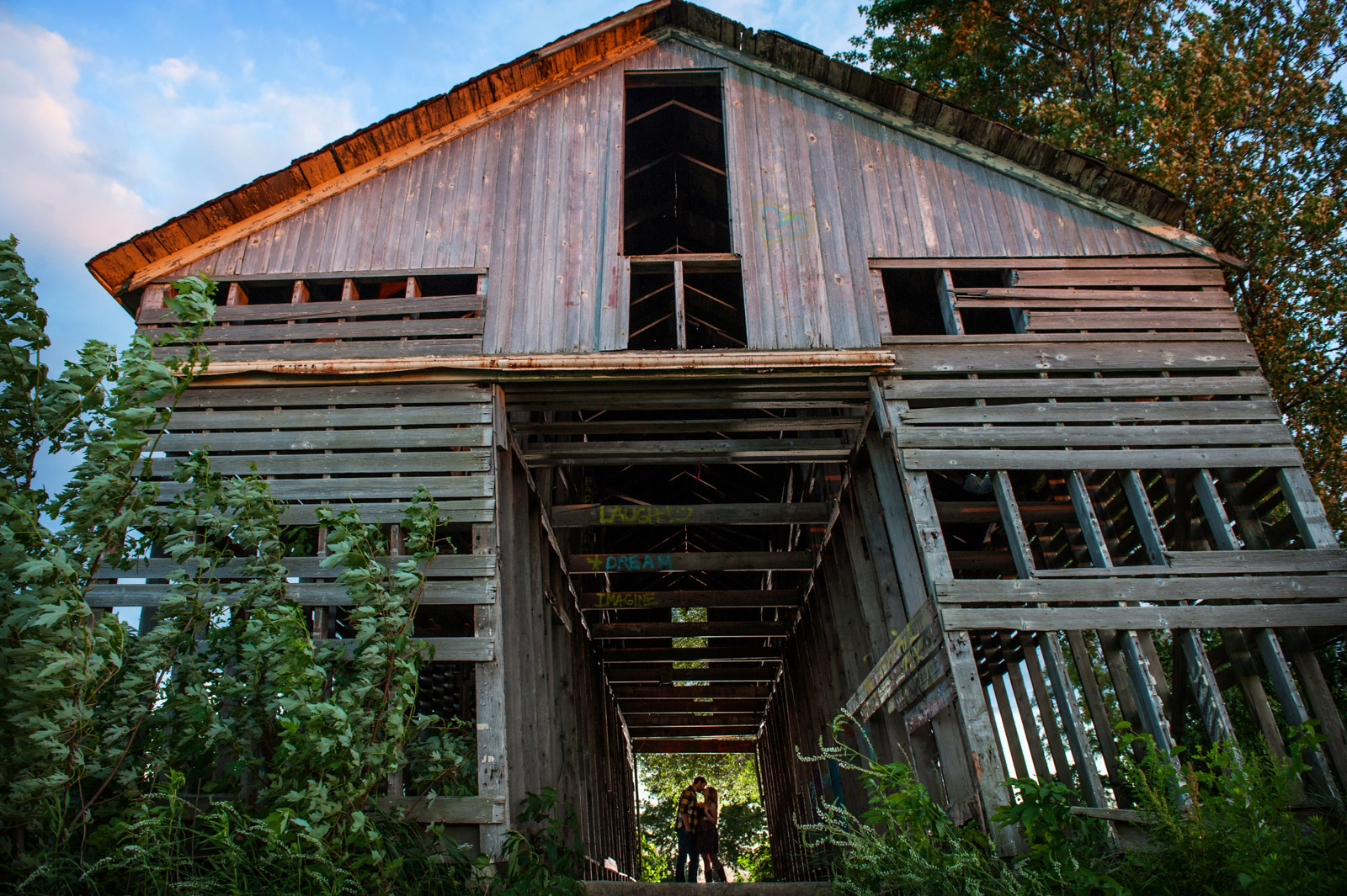 Engagement Session inside farm barn at sunset
