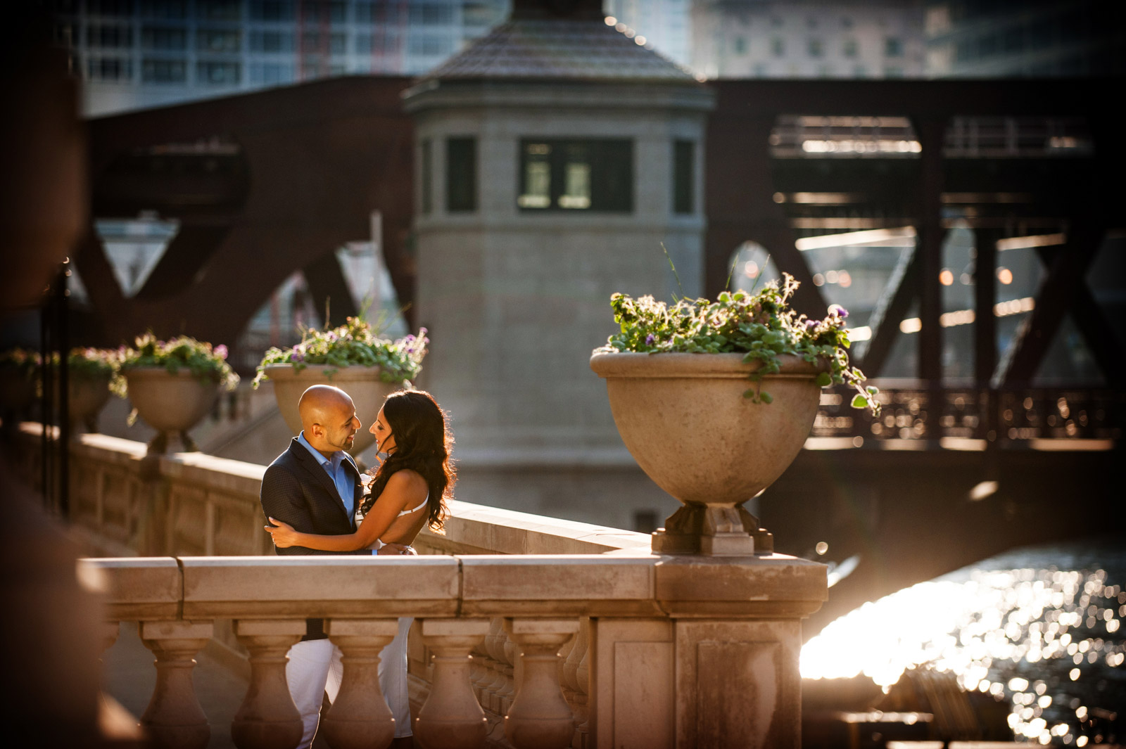 Engagement session in Chicago at sunset in the loop with El train and bridge in the background