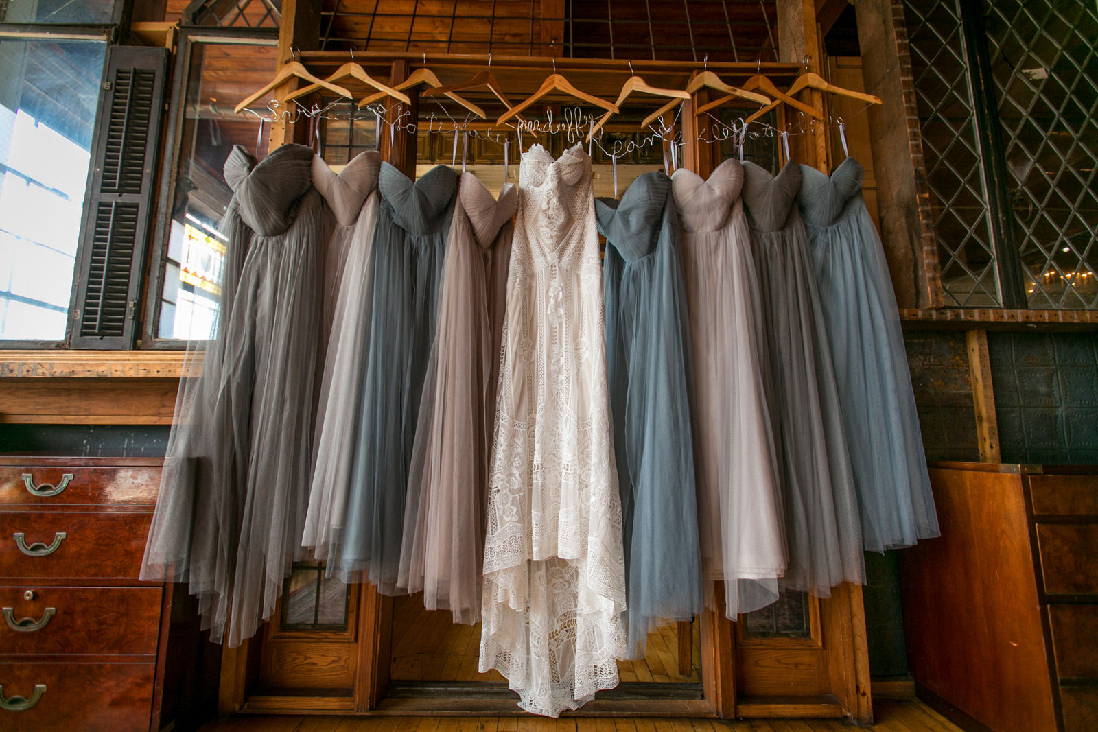 Bridesmaids Dresses hanging at Salvage One