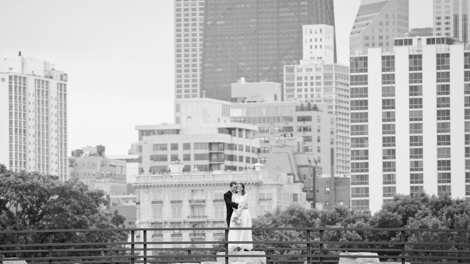 Bride and Groom in Chicago Lincoln Park Zoo South Pond on bridge in artistic Black and White photo