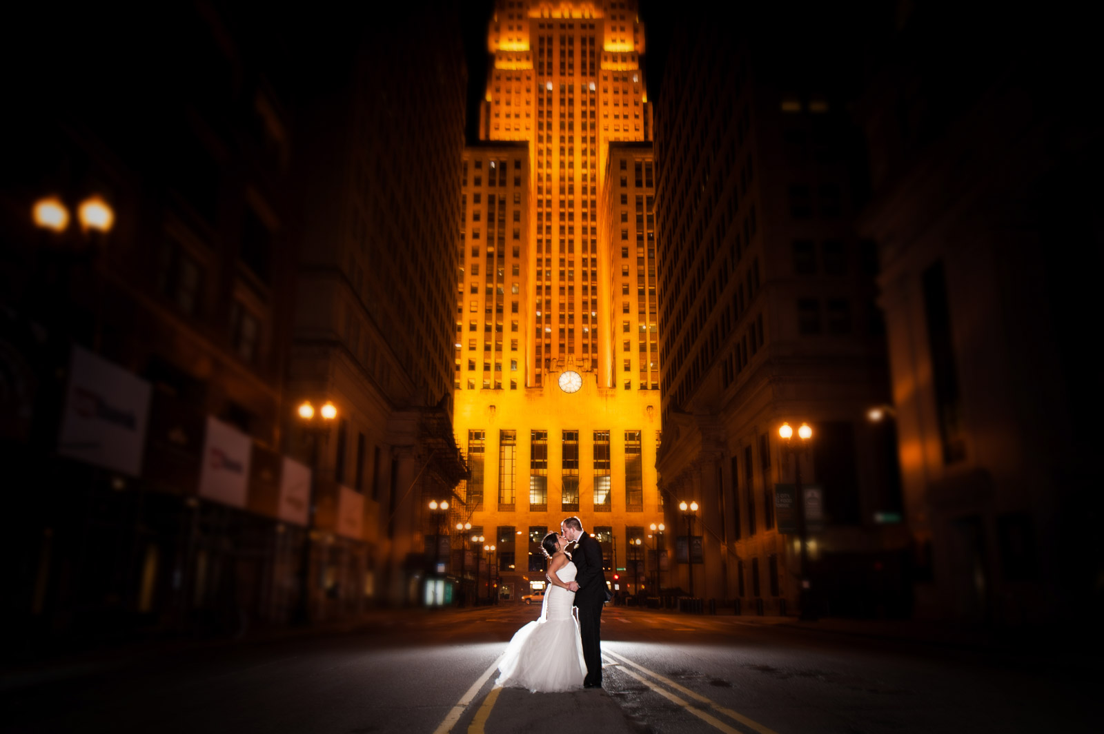 Bride and Groom kissing at Board of Trade in Chicago at night
