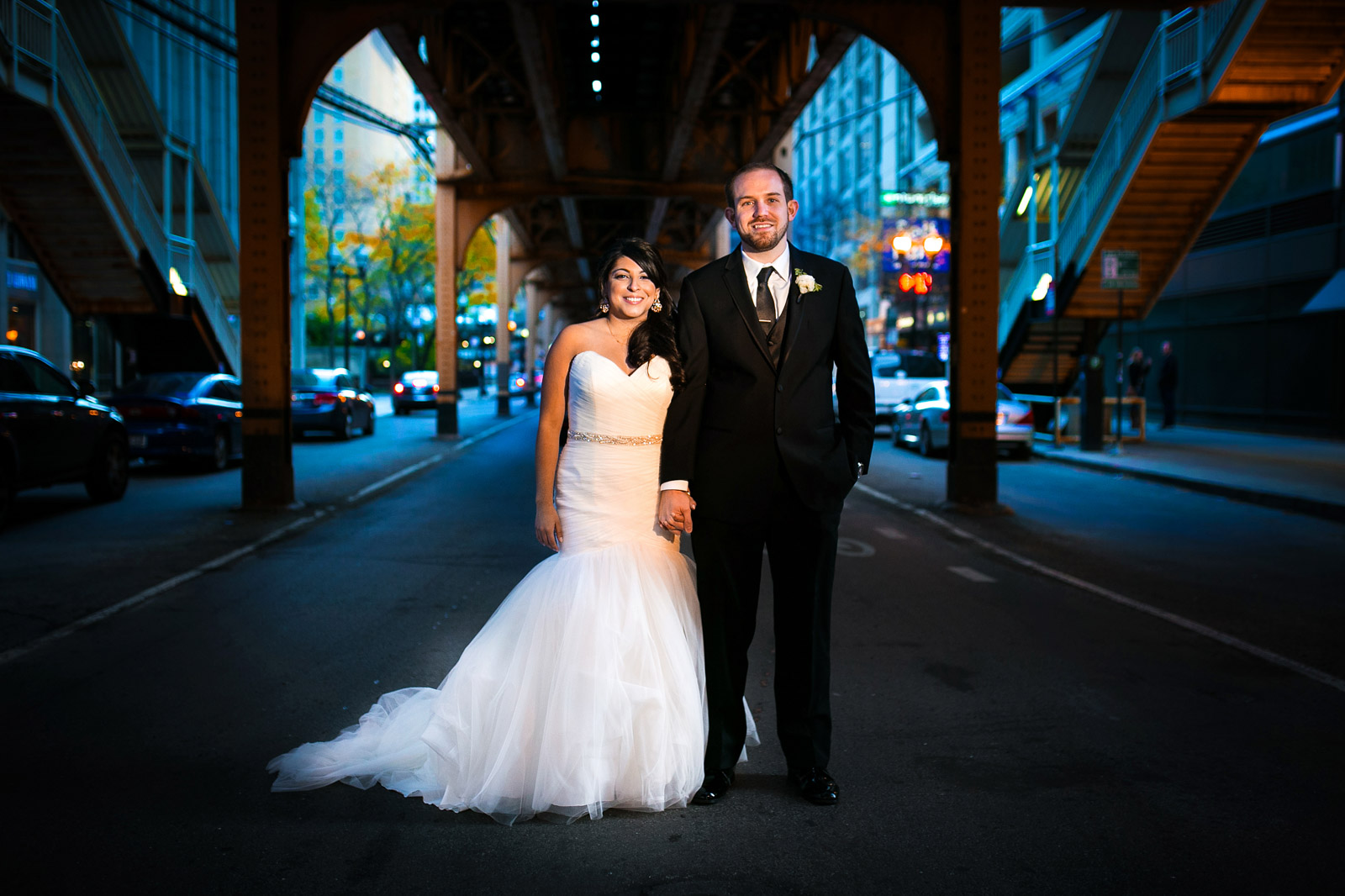 Bride and Groom in street under Chicago EL train track