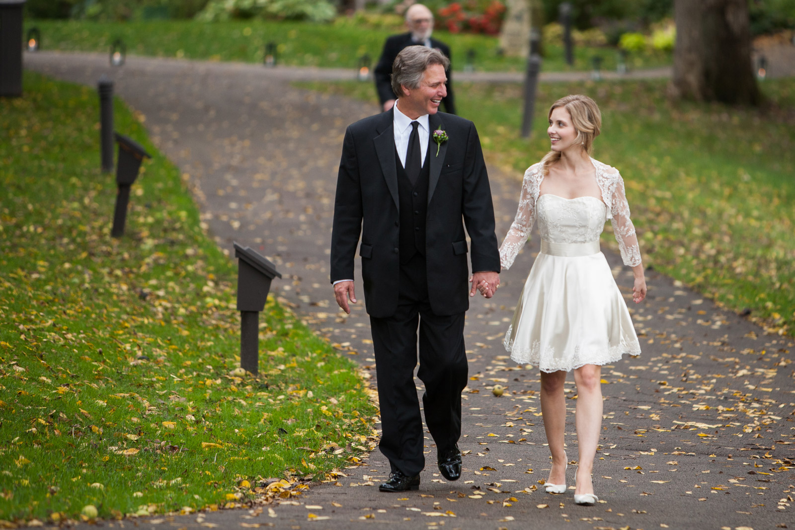 Bride and her father walking down the aisle to her Fall wedding at Eagle Ridge Resort and Spa in Galena Illinois