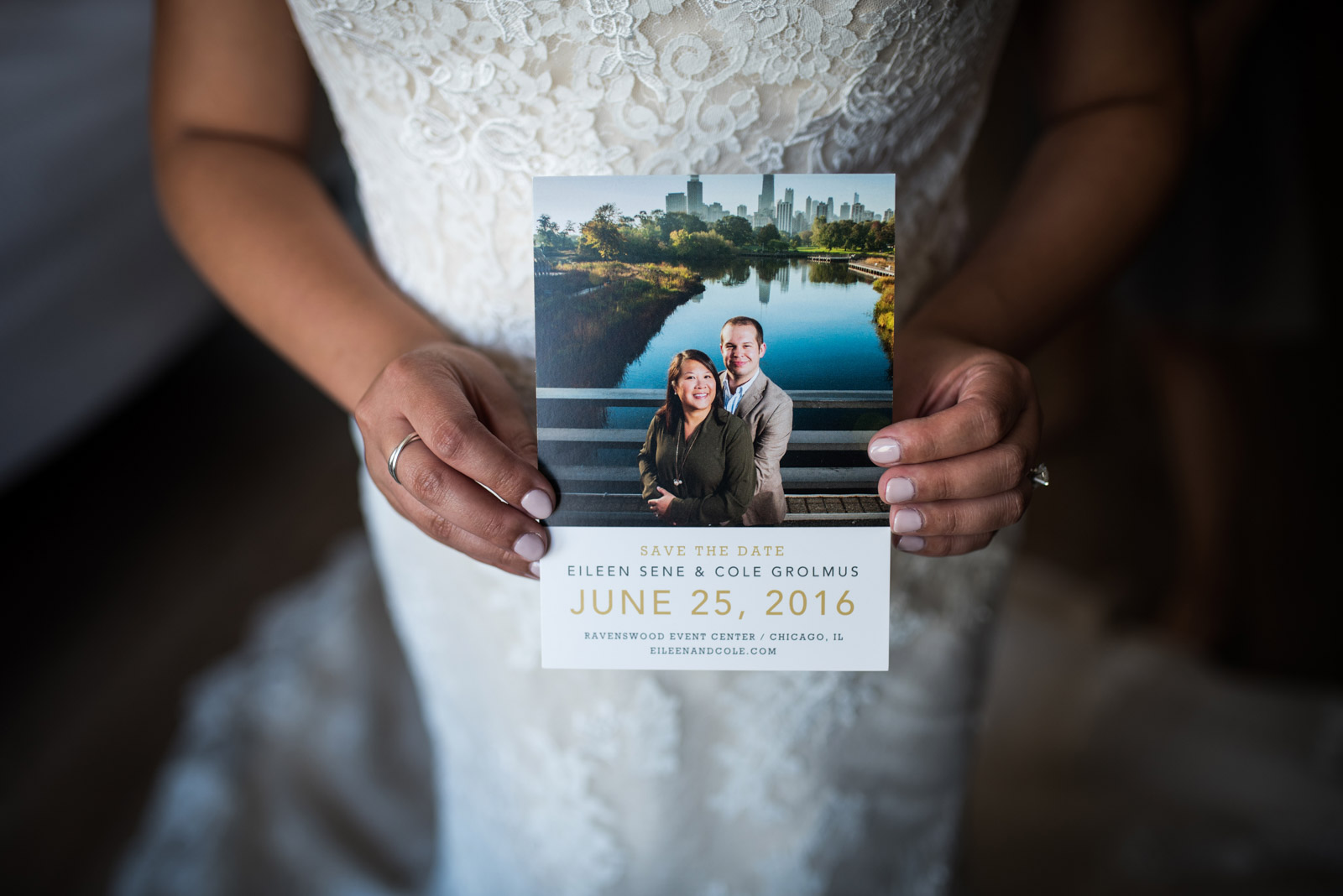Bride holding save the date during wedding day preparation