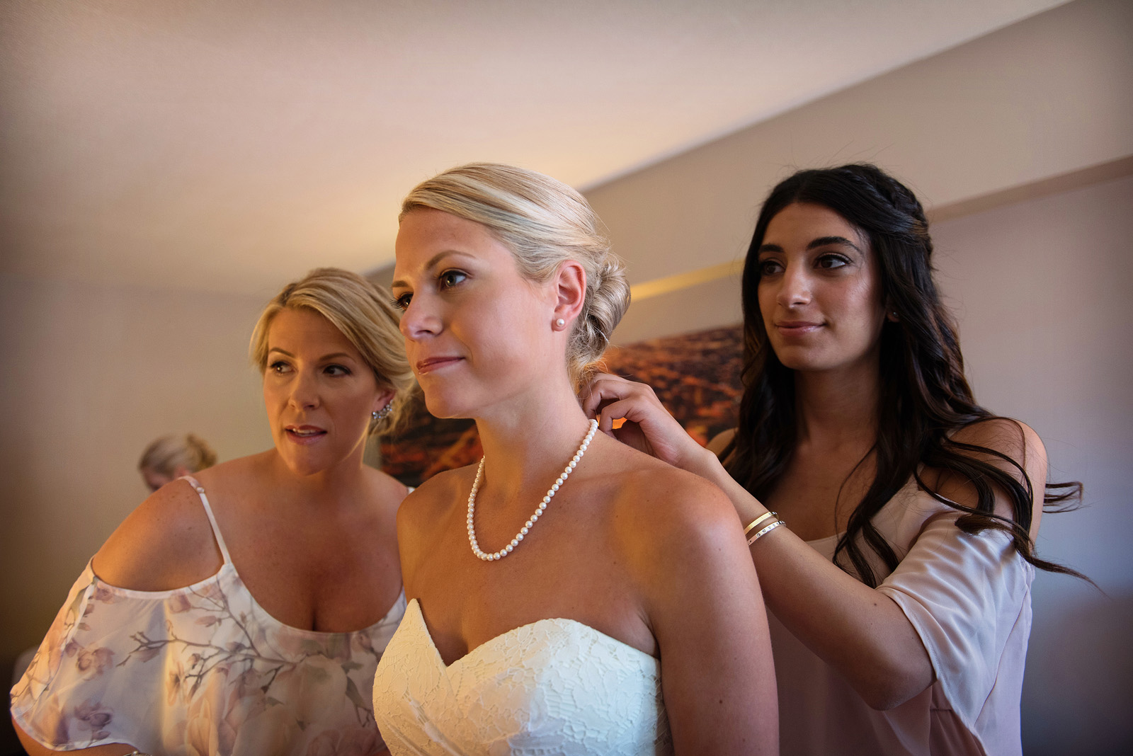 Bride preparing for wedding with sisters