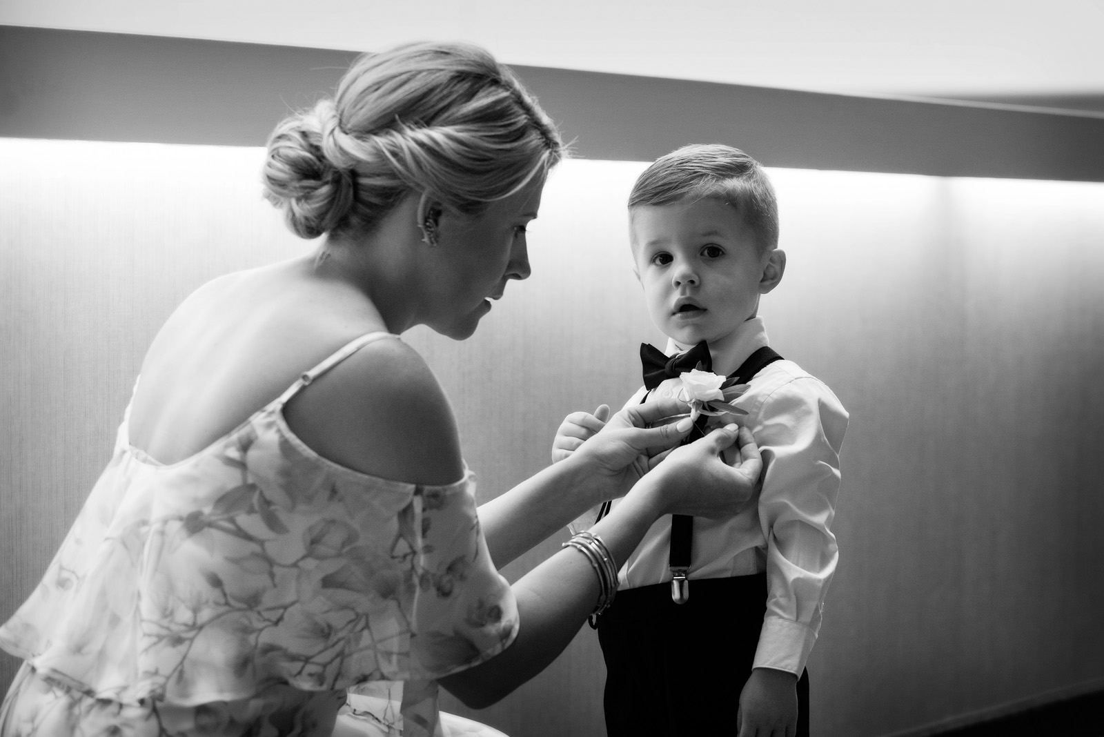 Ring Bearer getting flower pinned on by mom