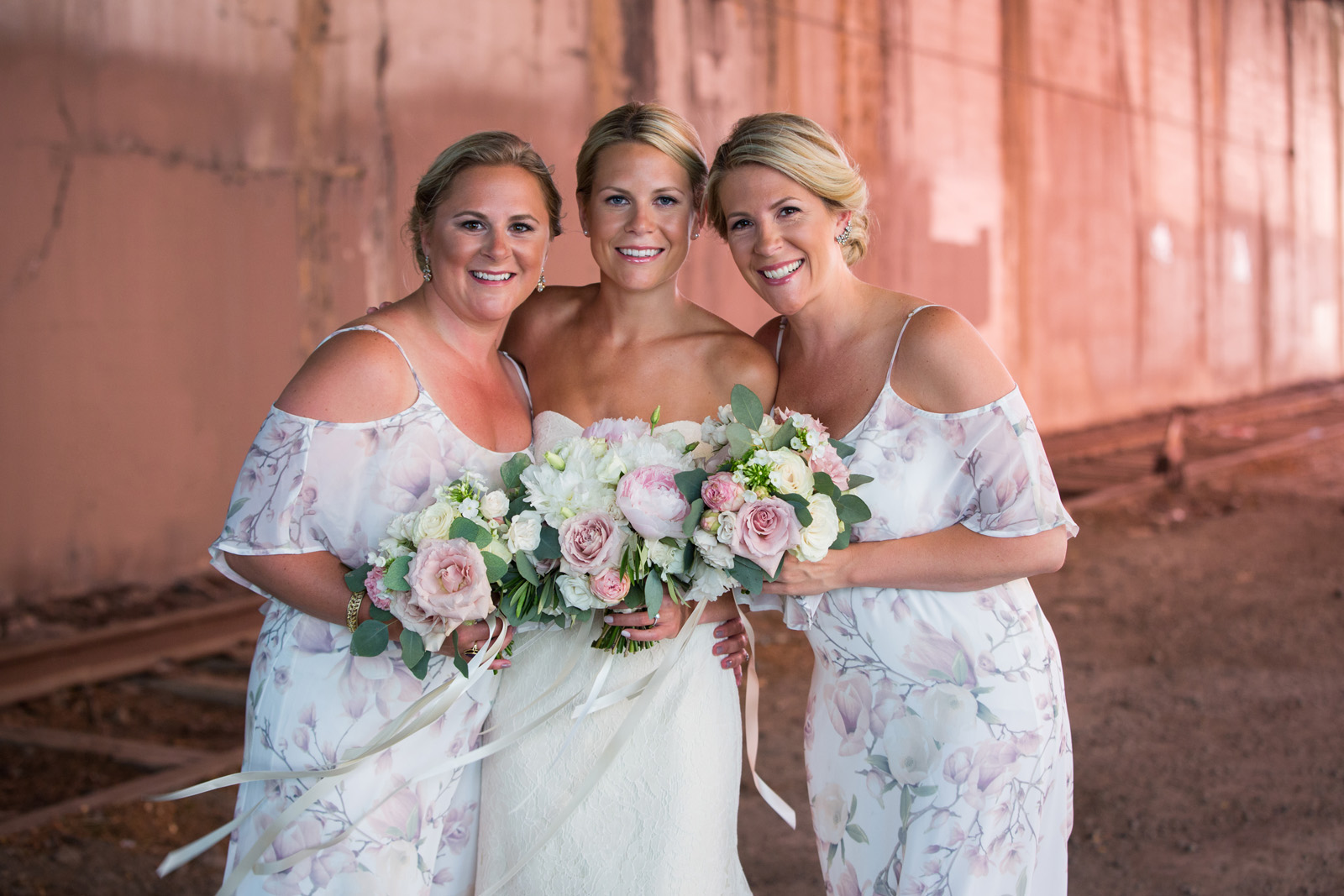 Portrait of bride with her sisters at wedding