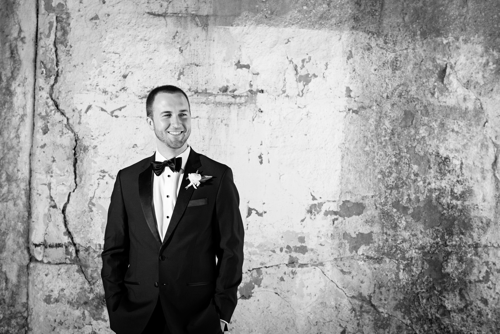 Urban black and white portrait of groom