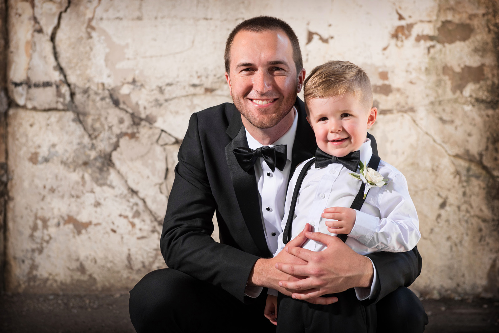 Photo of groom and ring bearer