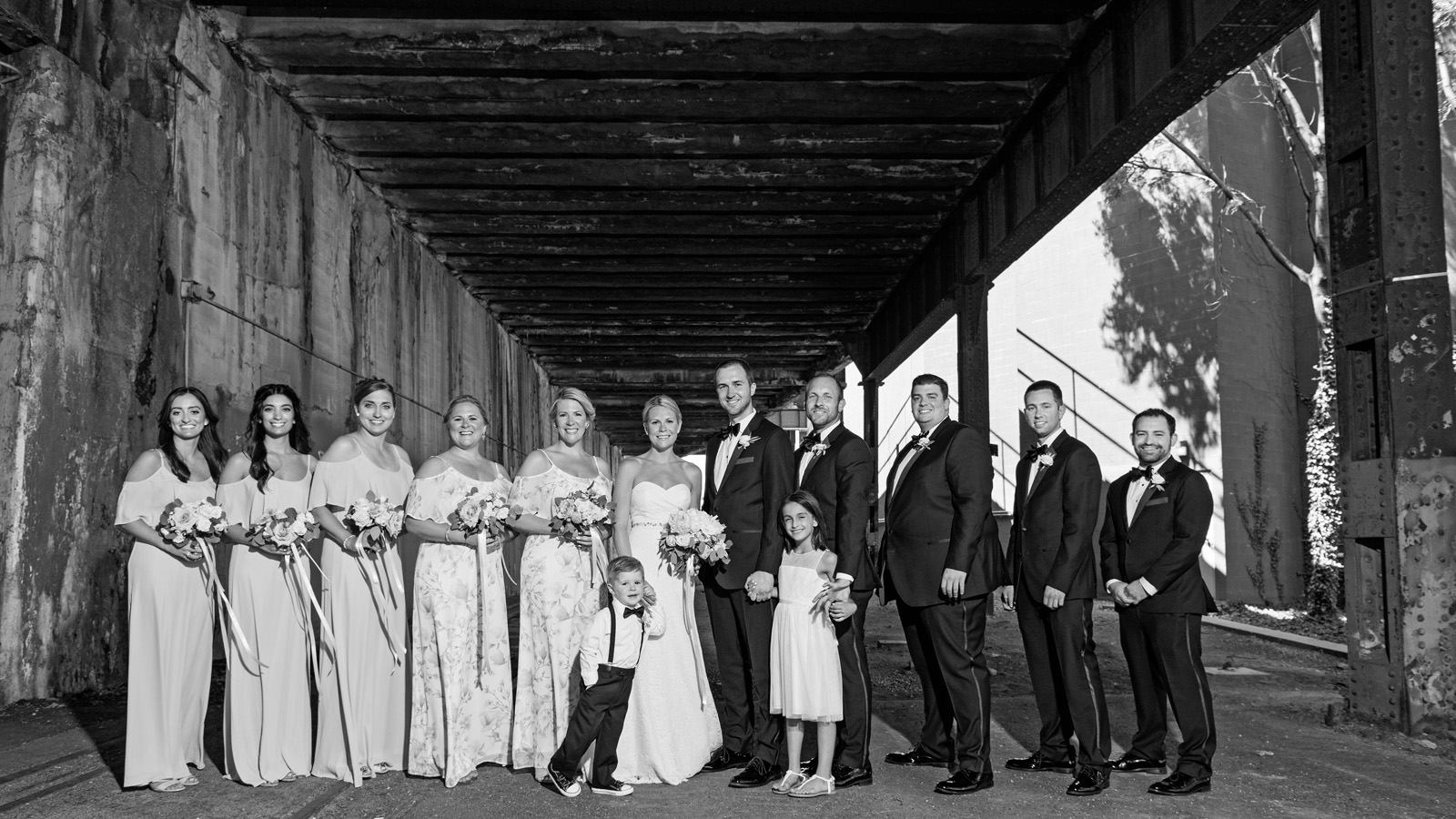 Black and White photo of wedding party under bride in Chicago
